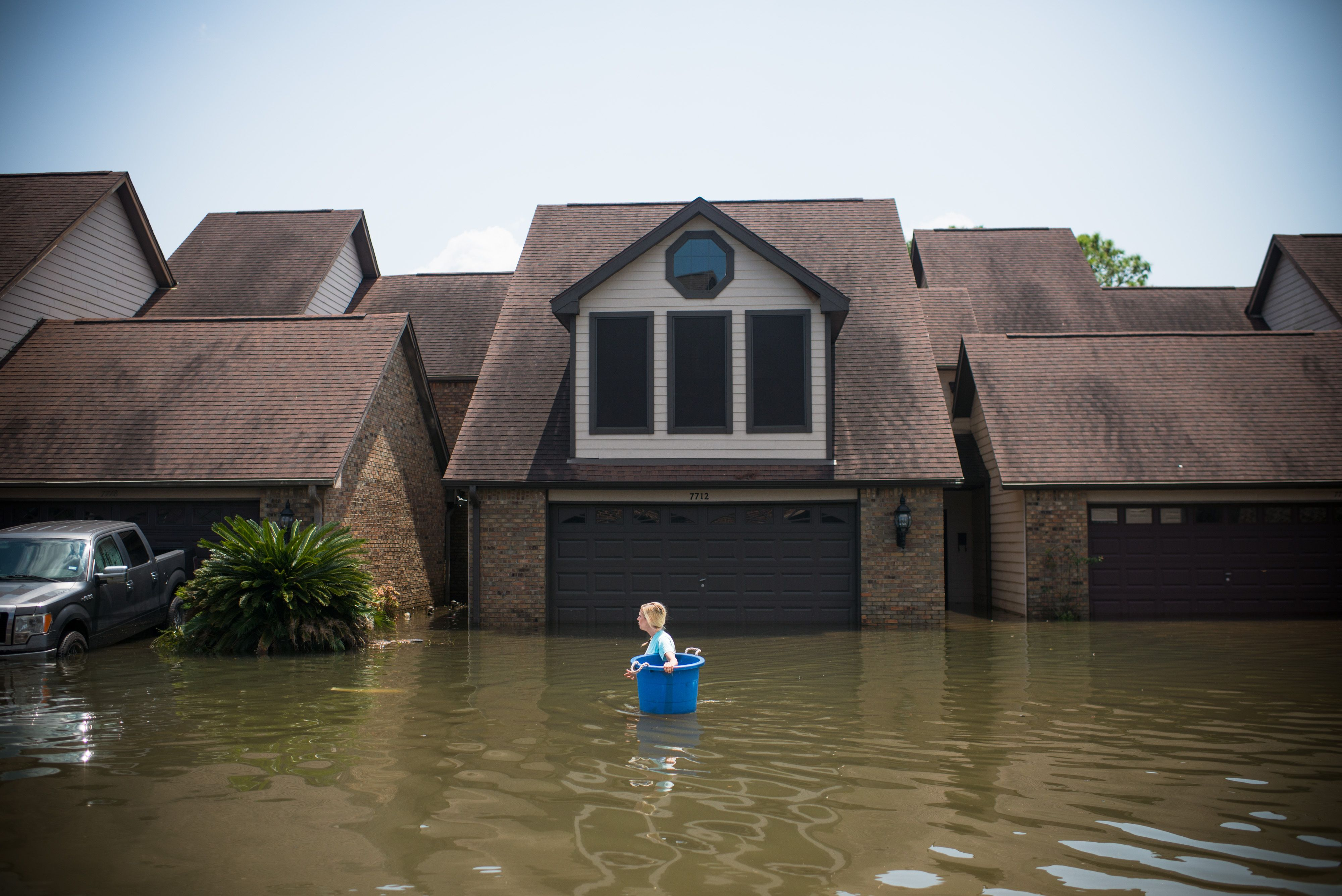 A woman walks through floodwaters in Port Arthur, Texas, on Sept. 1, 2017.