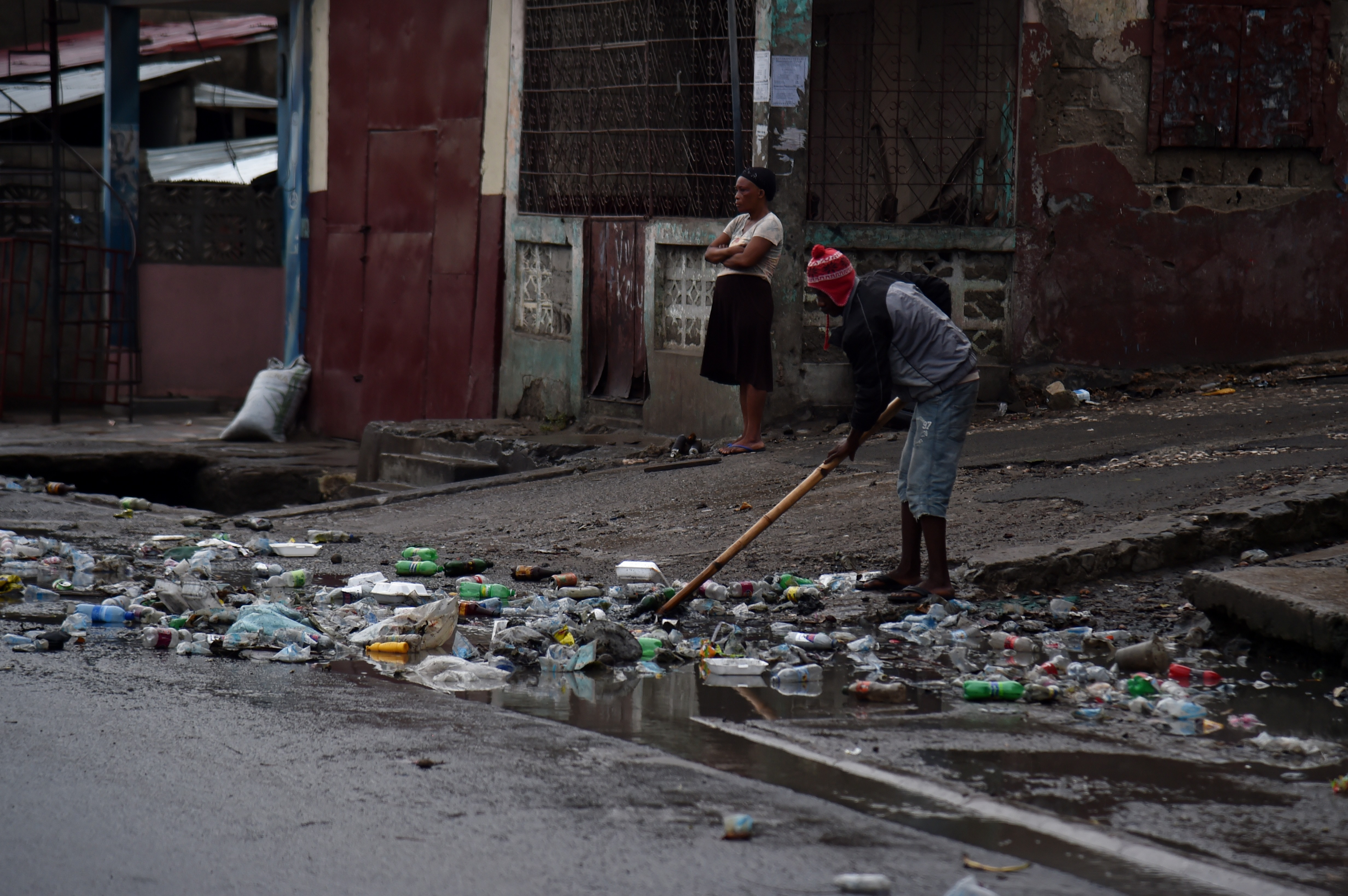 A man cleans after rains fell during the night before the arrival of Hurricane Irma, in Cap-Haitien, Haiti, on September 7, 2017.