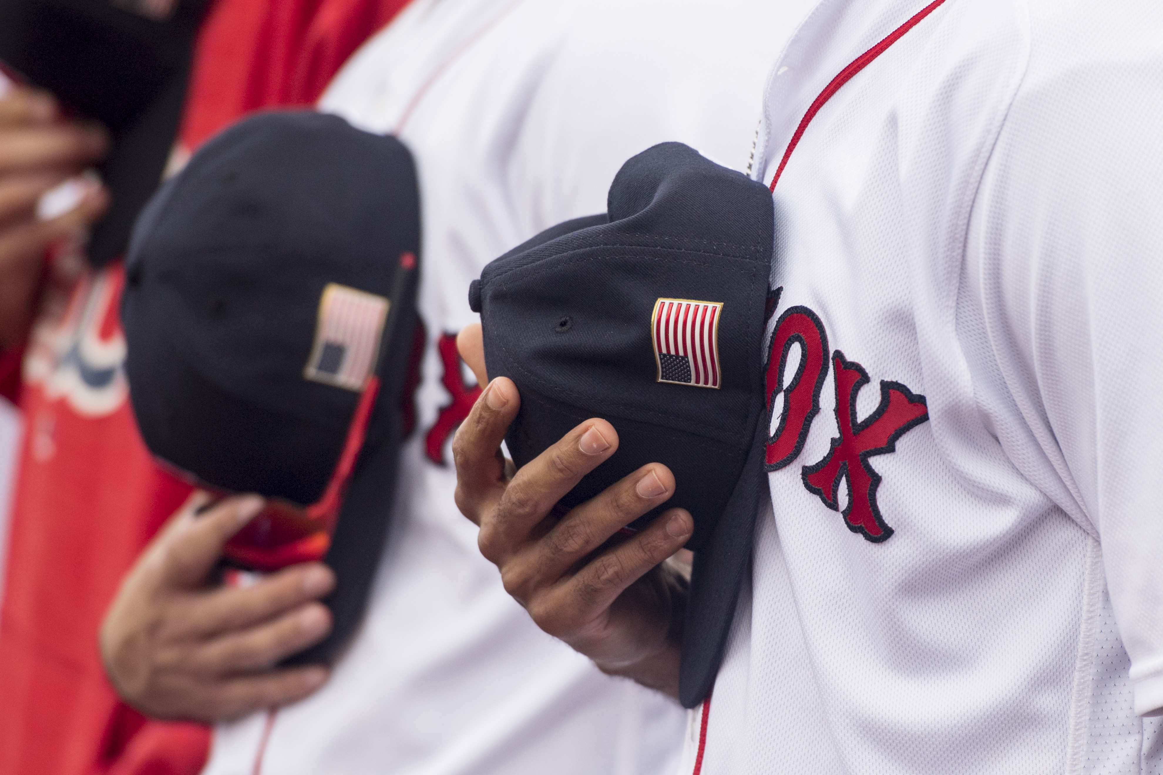 An American flag patch is shown on a cap before a game between the Boston Red Sox and the Tampa Bay Rays on September 10, 2017 at Fenway Park in Boston, Massachusetts. (Photo by Billie Weiss/Boston Red Sox/Getty Images)