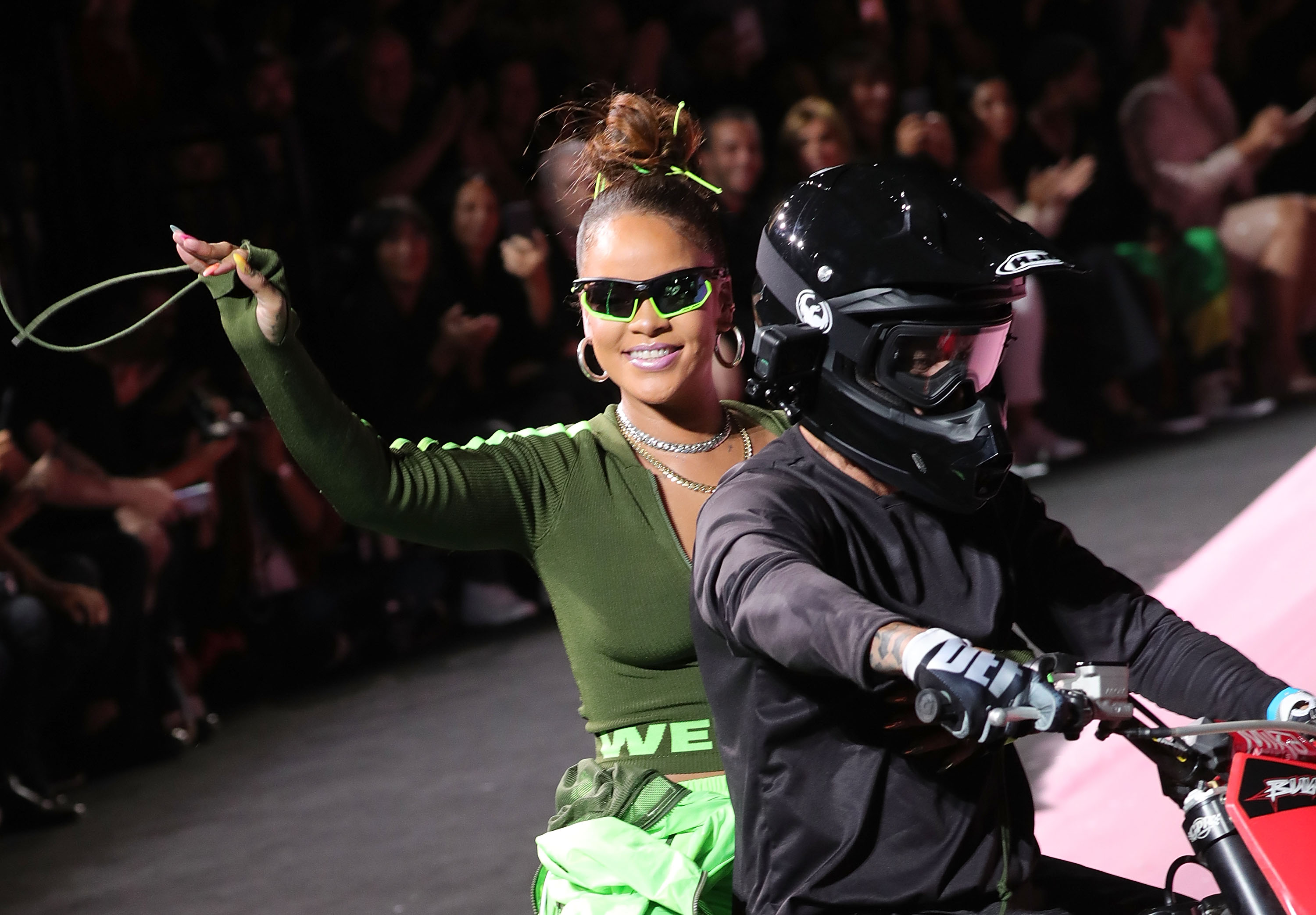 NEW YORK, NY - SEPTEMBER 10:  Rihanna waves from the back of a motorcycle at the finale of the Fenty Puma by Rihanna show during New York Fashion Week at the 69th Regiment Armory on September 10, 2017 in New York City.  (Photo by Paul Morigi/WireImage)