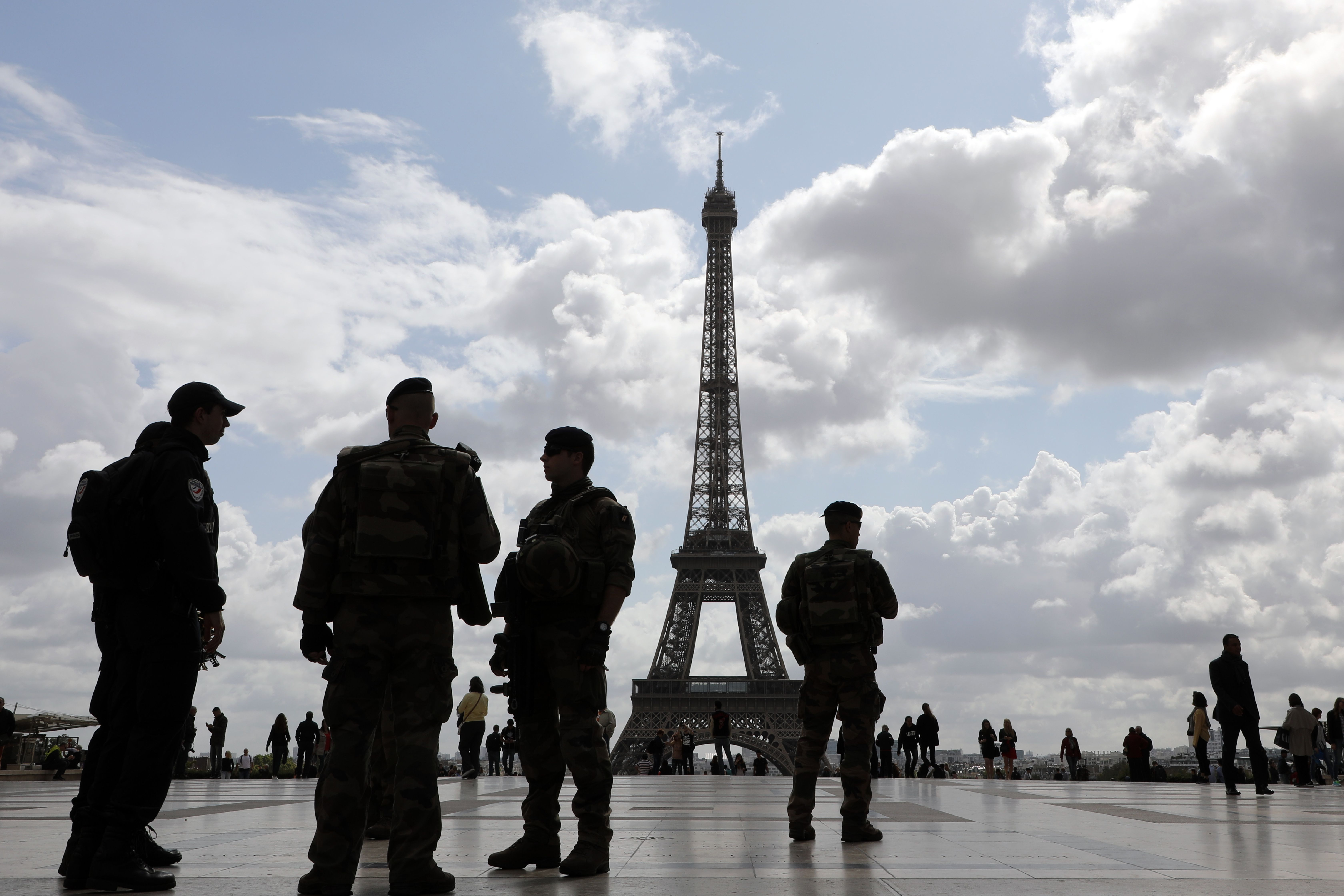 Policemen and French soldiers from the Sentinelle operation patrol on the trocadero Square on september 12, 2017, in Paris.