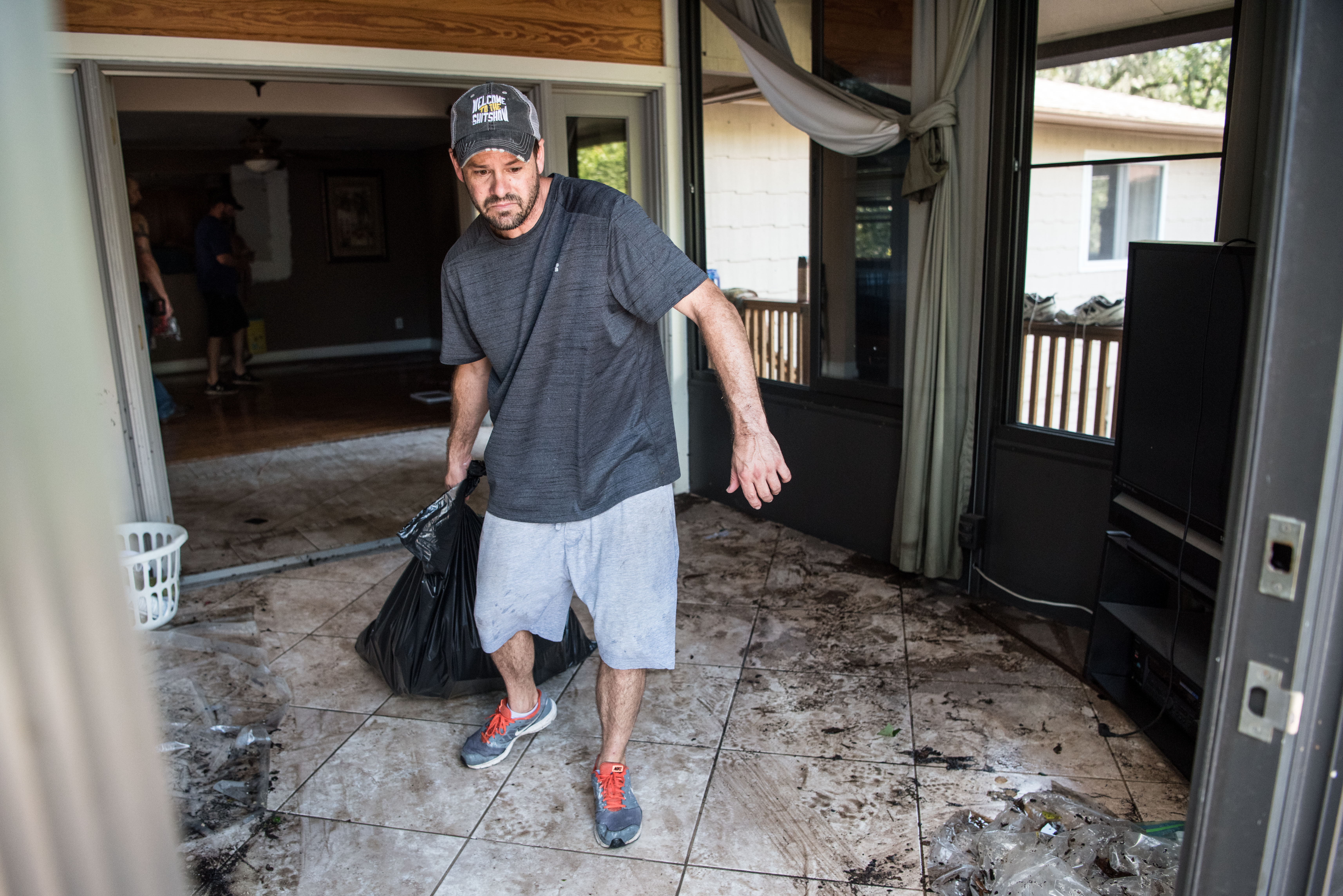 David Dionne helps to clean up as floodwaters from Hurricane Irma recede September 13, 2017 in Middleburg, Florida.