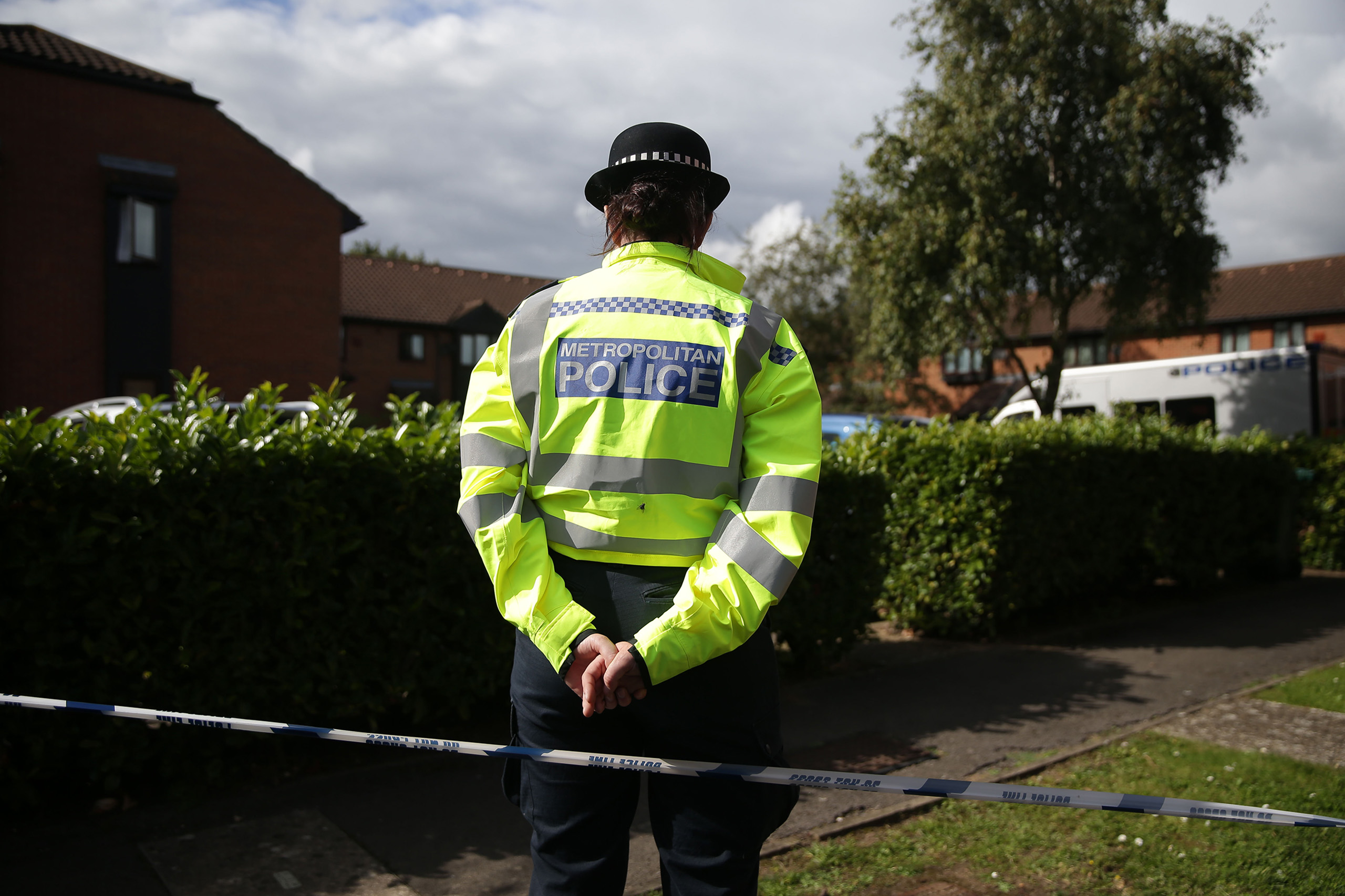 Police stand guard during a search by a police forensics team of a house in Stanwell, Surrey near London on Sept. 17, 2017.