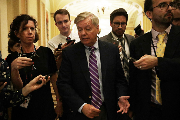 U.S. Sen. Lindsey Graham (R-SC) (C) speaks to members of the media after the weekly Senate Republican policy luncheon at the Capitol September 19, 2017 in Washington, DC.