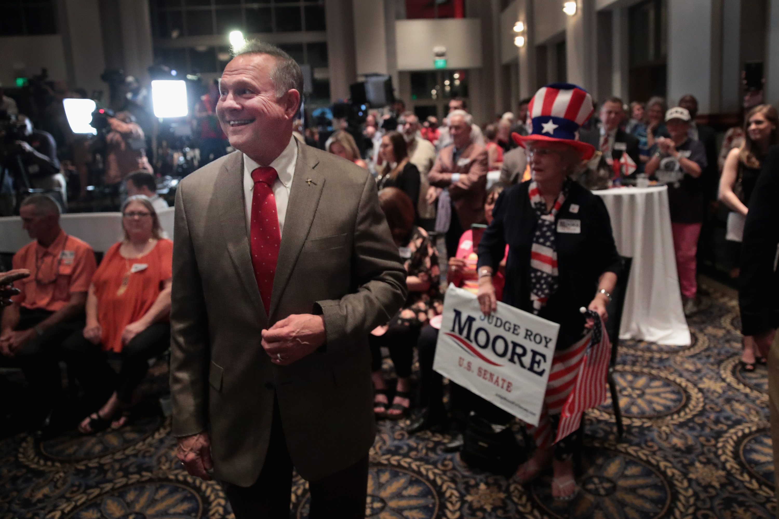 Roy Moore greets guests at an election-night rally on September 26, 2017 in Montgomery, Alabama. Moore, former chief justice of the Alabama supreme court, defeated Luther Strange, who was backed by President Trump, for the Senate seat vacated by Attorney General Jeff Sessions.