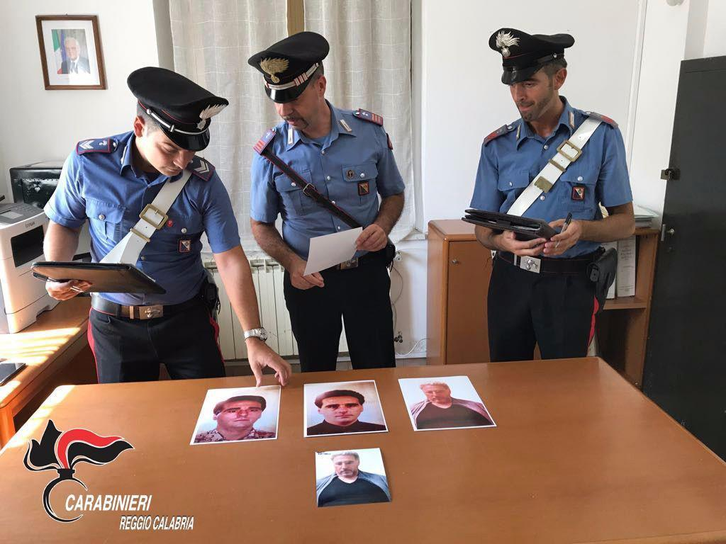 A handout photo made available by the Italian Carabinieri police shows three carabinieri police looking at pictures of 'Ndrangheta boss Rocco Morabito before and after his capture on 04 September 2017.