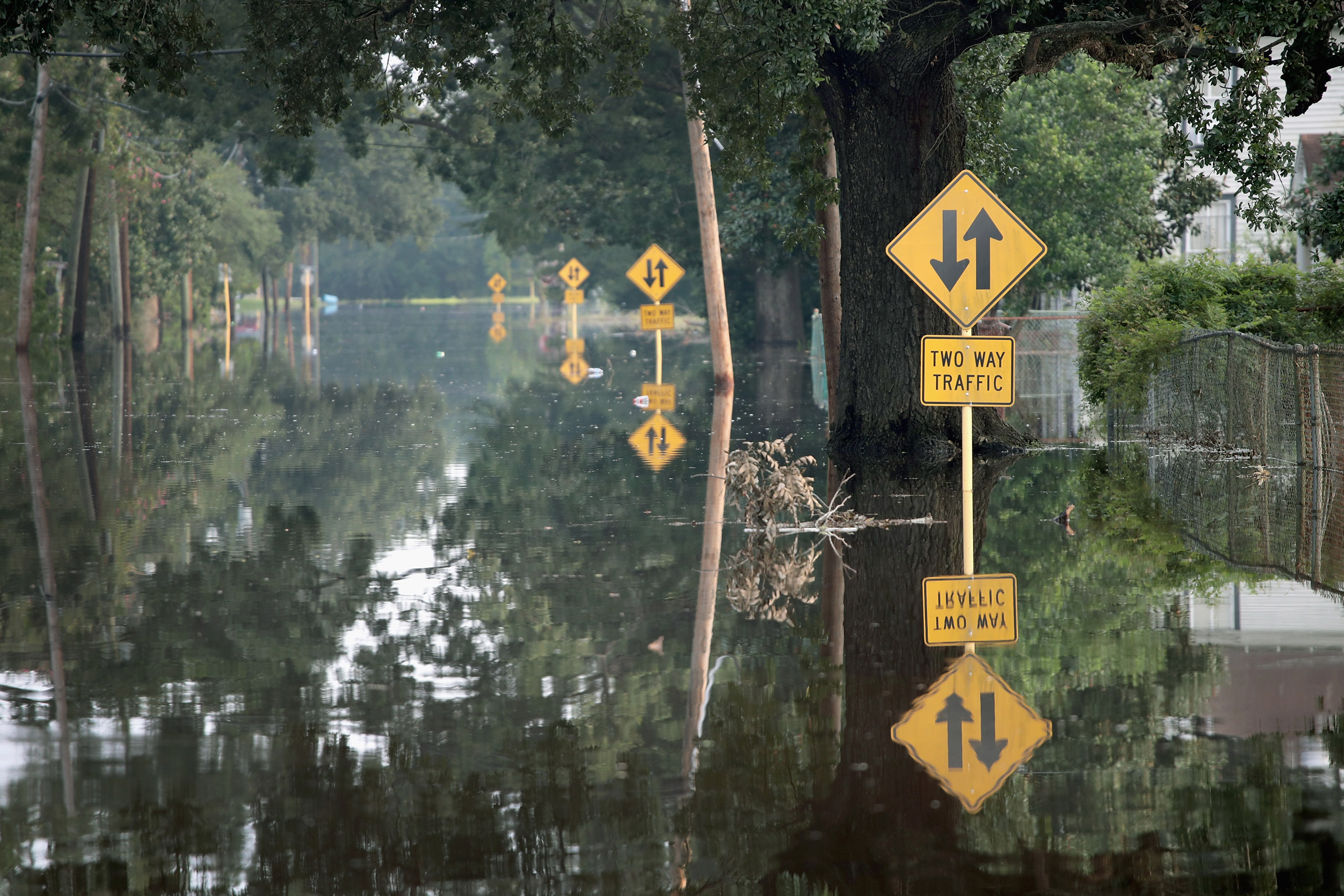 A street is covered with floodwater after torrential rains pounded Southeast Texas following Hurricane Harvey on Sept. 3, 2017 in Orange, Texas.
