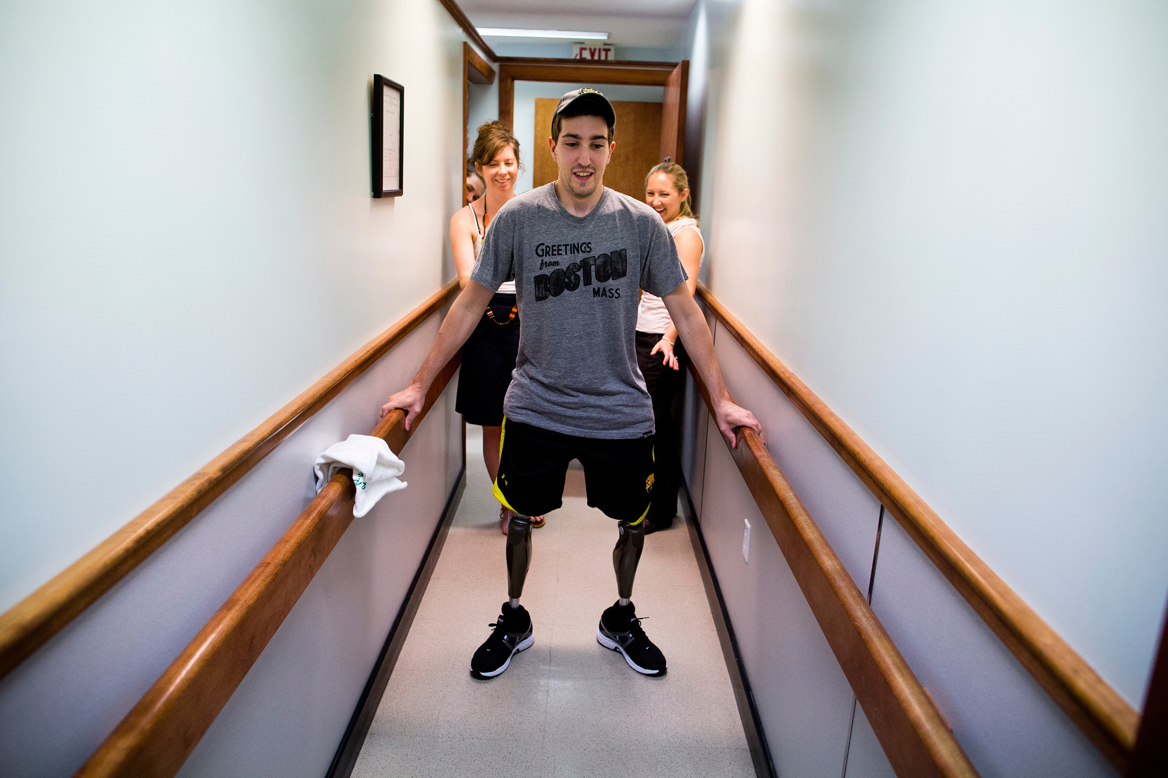 Bauman walks on his own for the first time since the marathon at a final fitting for his prosthetic legs in Massachusetts on May 31, 2013.