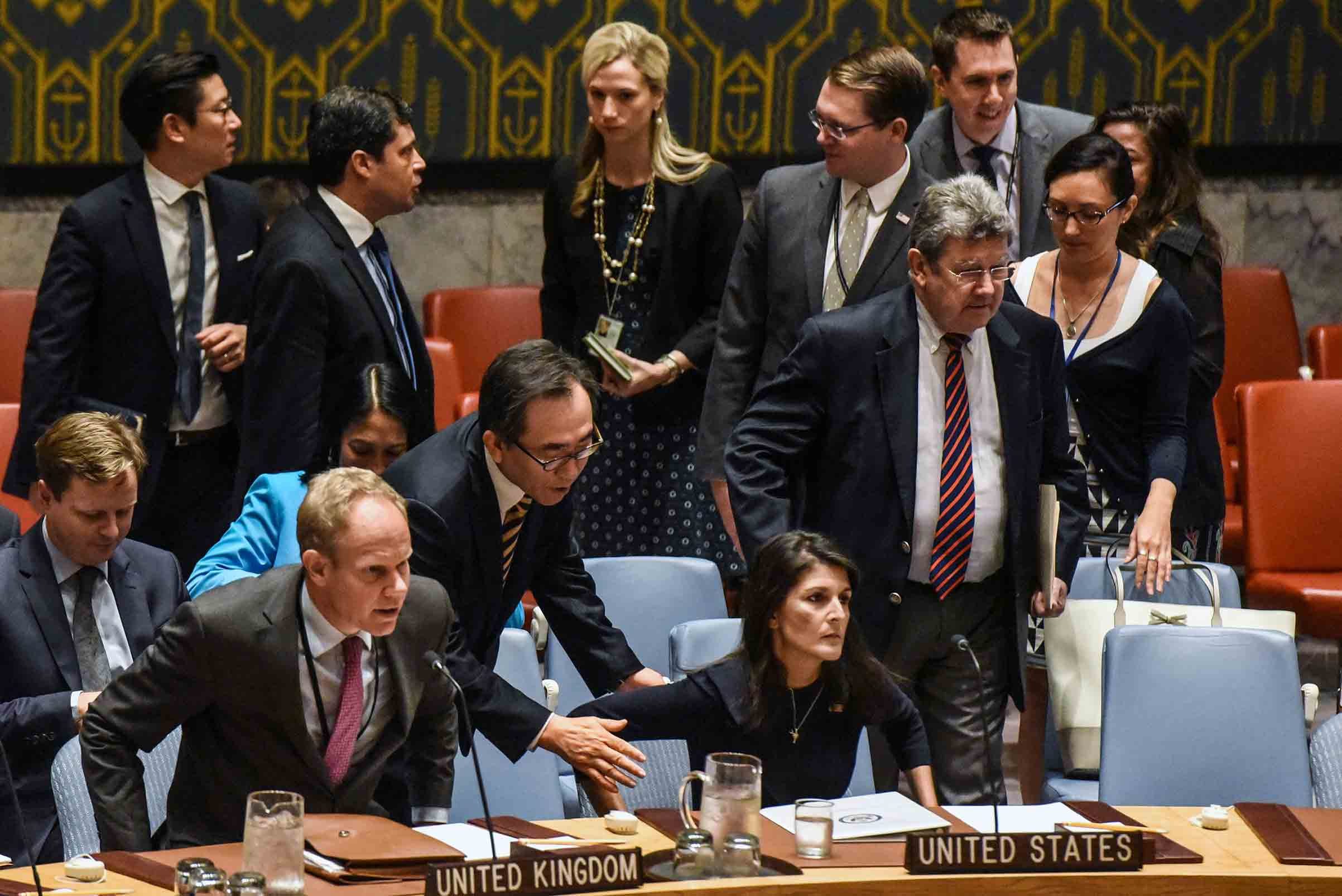 South Korean Ambassador Cho Tae-Yul tries to get the attention of Ambassador to the UN, Nikki Haley during a United Nations Security Council meeting on North Korea on Sept. 4 in New York City.