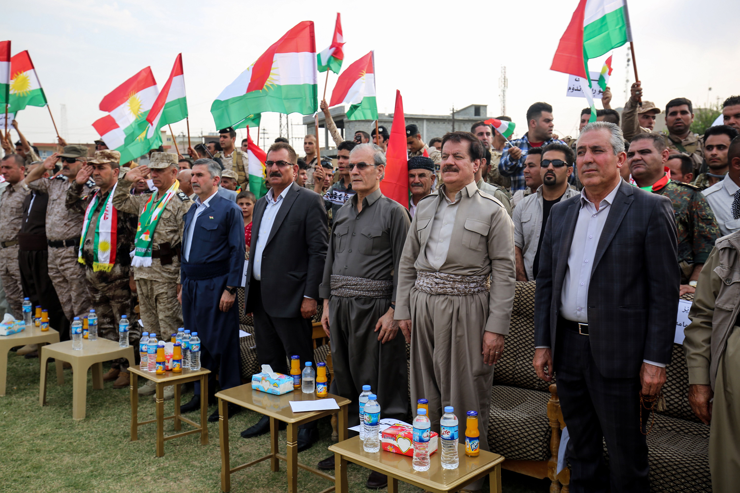 Kirkuk's provincial governor Najim al-Din Karim third from right, who was recently sacked by the Iraqi parliament, attends a rally in support of the upcoming independence referendum in Kirkuk on Sept. 19, 2017