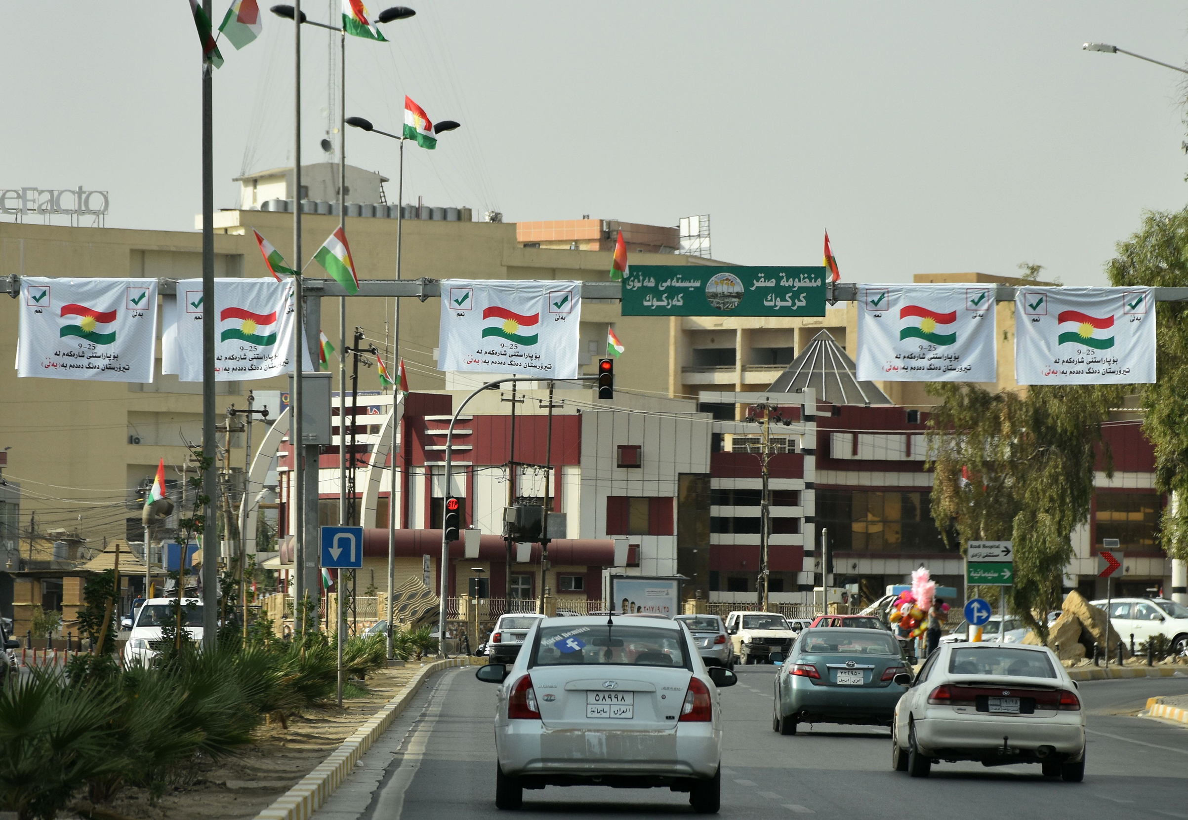 Posters encouraging people to vote in the upcoming independence referendum are seen in central Kirkuk on Sept. 21, 2017.