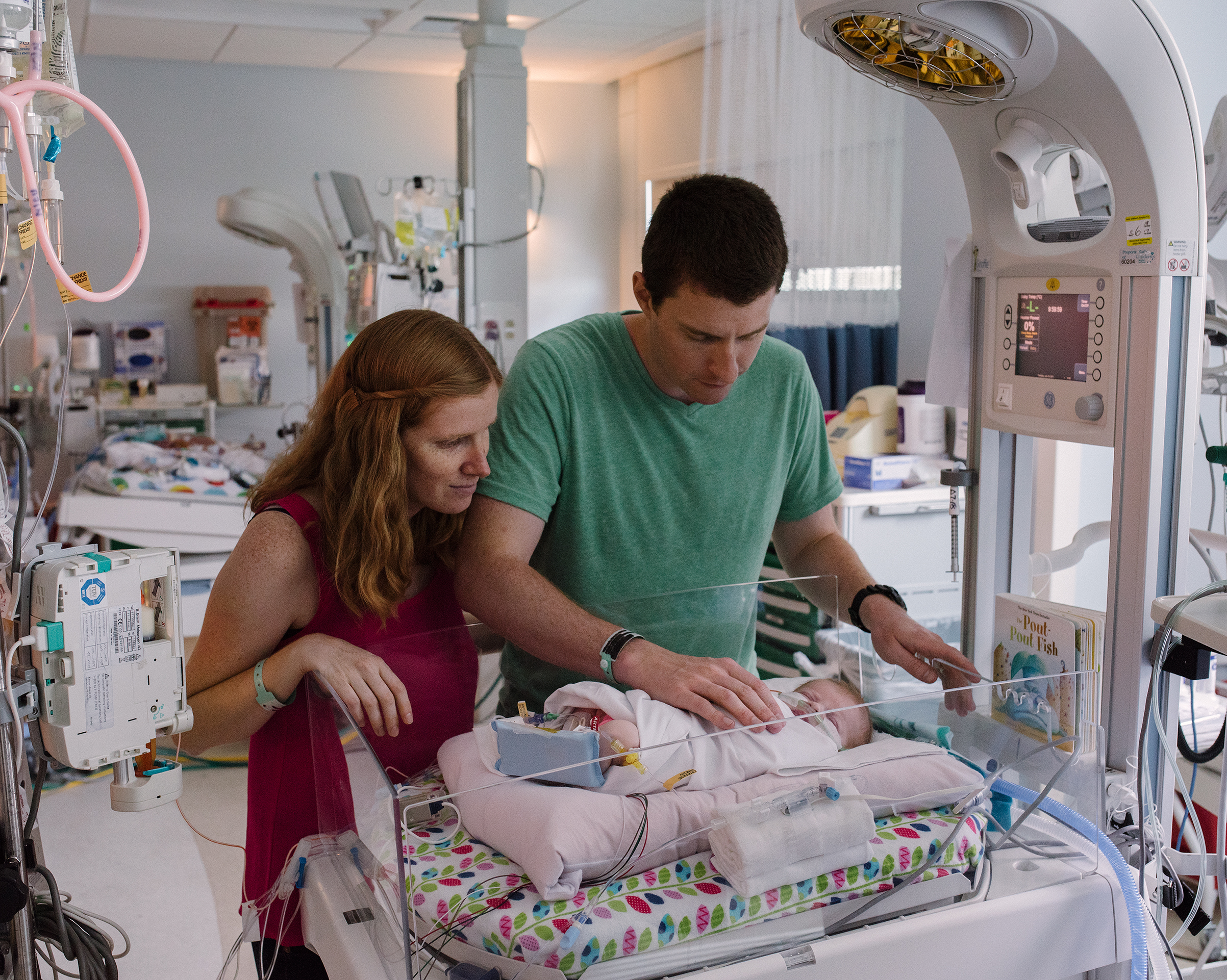 Elizabeth and Tristan Holbrook spend time with their newborn daughter Grace, Rady Children's Hospital, San Diego, CA, July 18, 2017