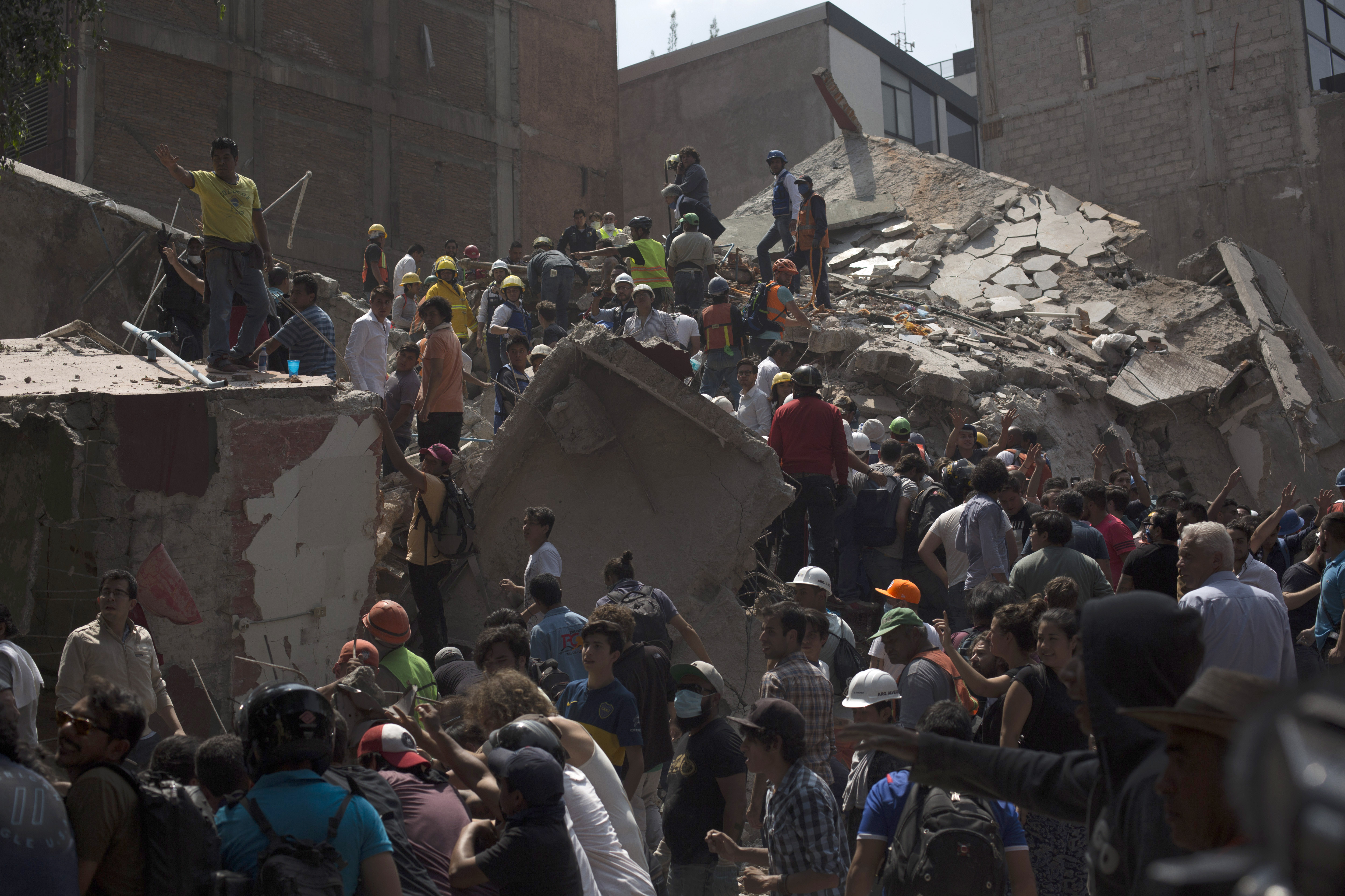 Rescuers work in the rubble after a magnitude 7.1 earthquake struck on September 19, 2017 in Mexico City, killing over 100 people and causing massive damage.