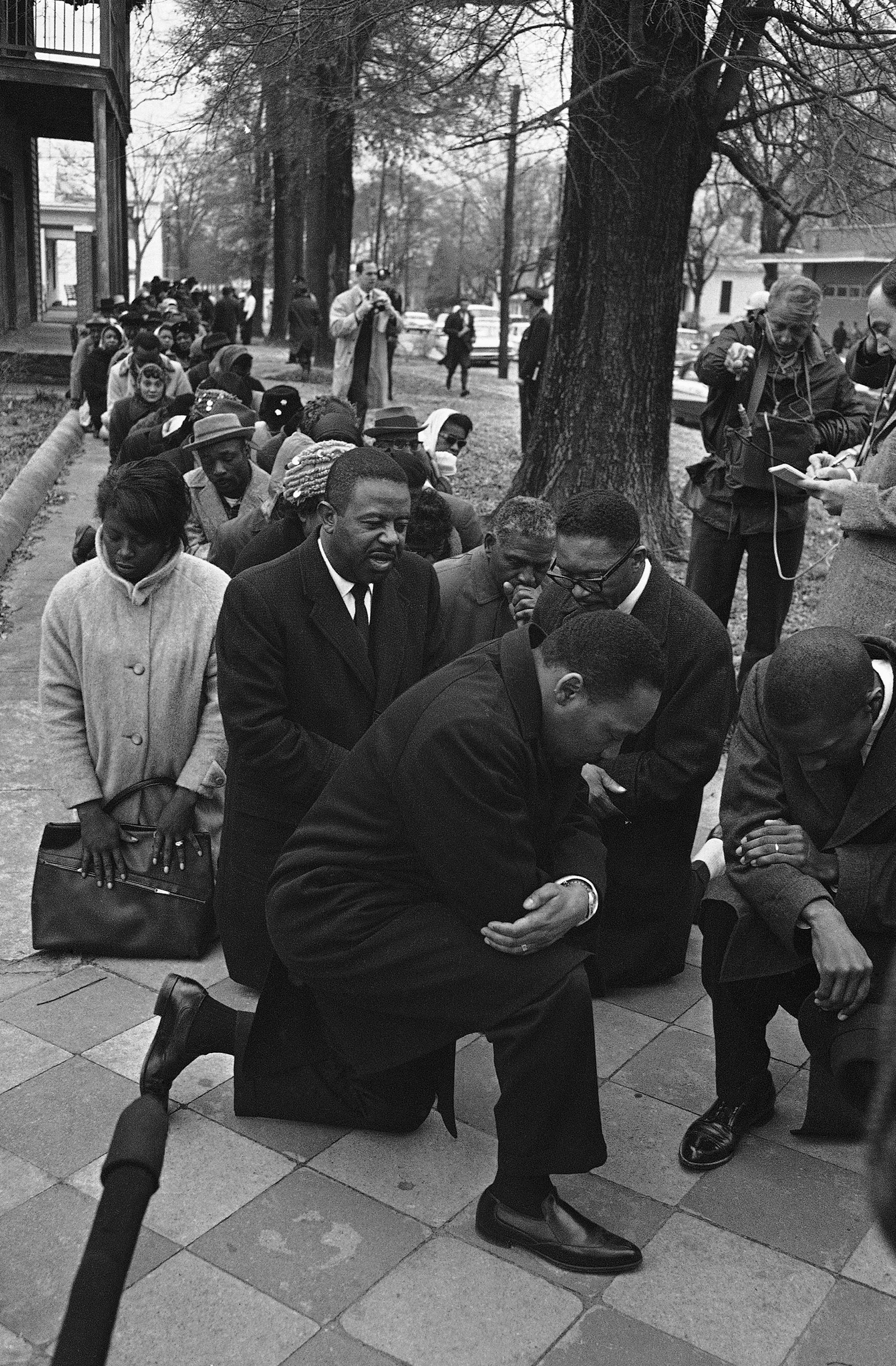 Dr. Martin Luther King Jr., center, leads a group of civil rights workers and Selma black people in prayer on Feb. 1, 1965 in Selma, Alabama after they were arrested on charges of parading without a permit. More than 250 persons were arrested as they marched to the Dallas County courthouse as part of a voter registration drive.