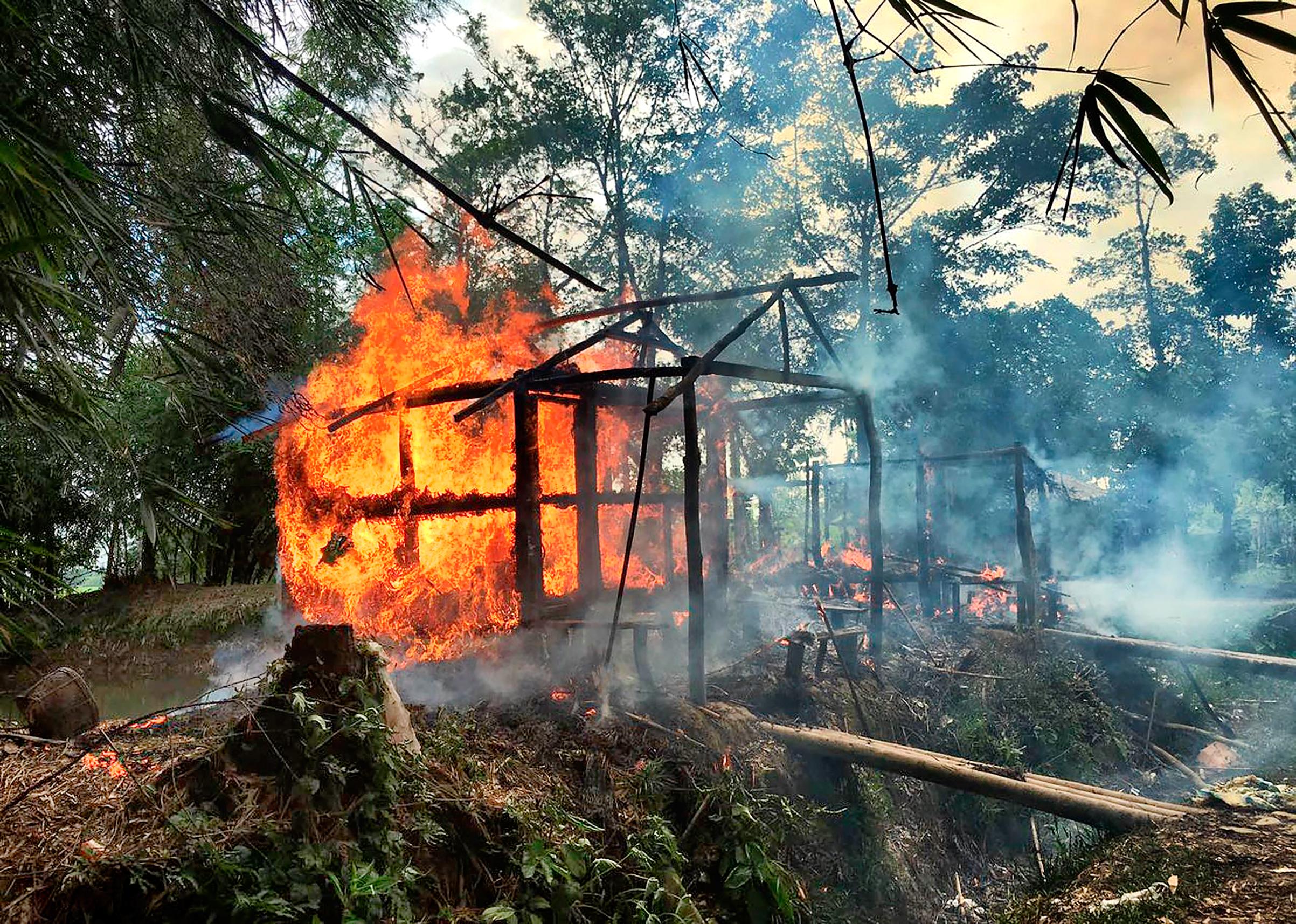 A Rohingya village burning in Rakhine state on Sept. 7.