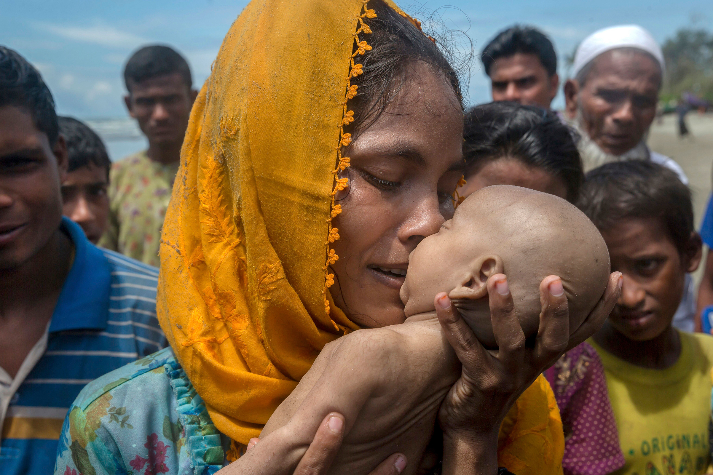 A Rohingya woman grieves for her infant son, who died when their boat capsized off Bangladesh on Sept. 14.