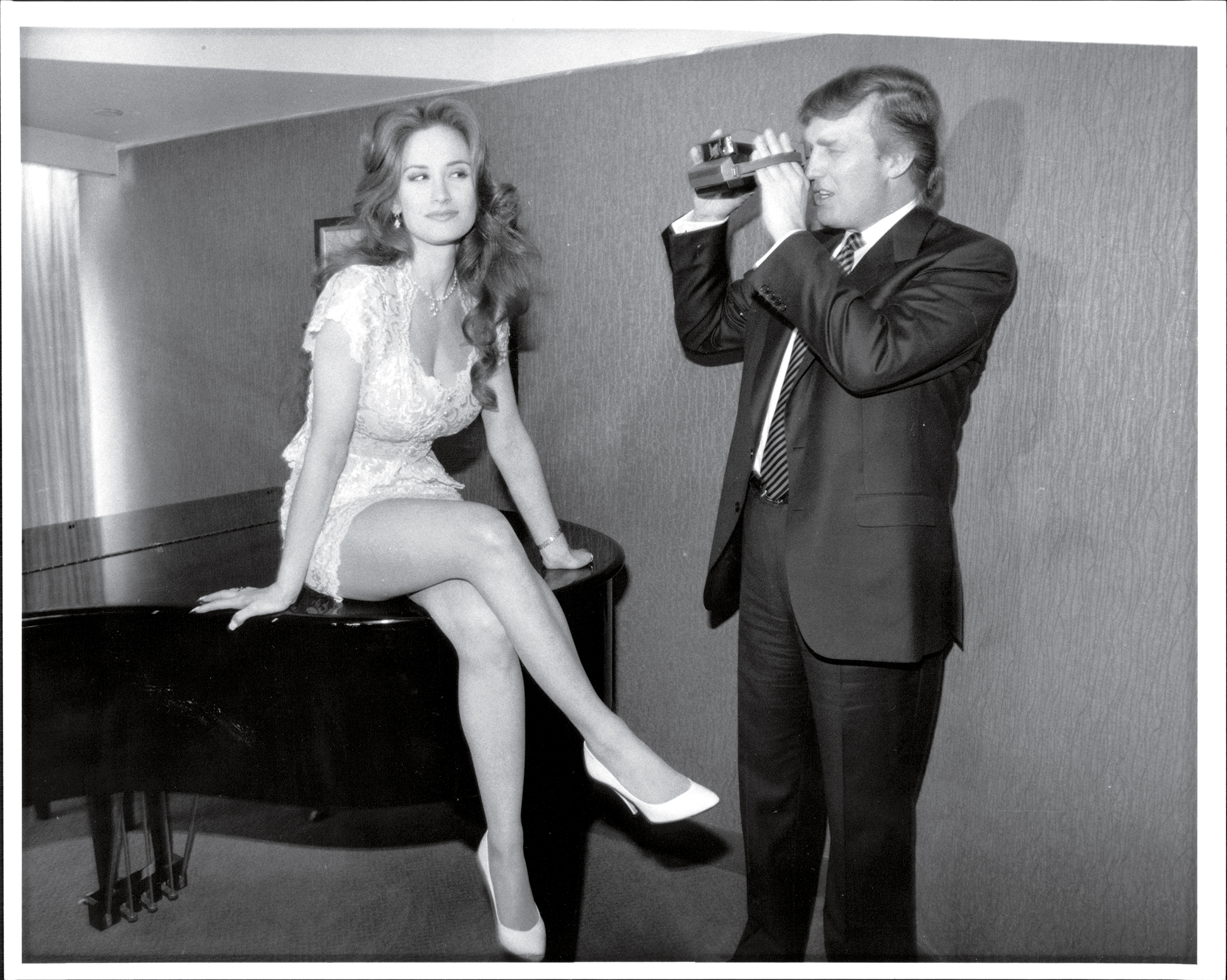 Trump photographs a Playmate candidate during Playboy's 40th Anniversary Playmate Search in New York City in 1993.