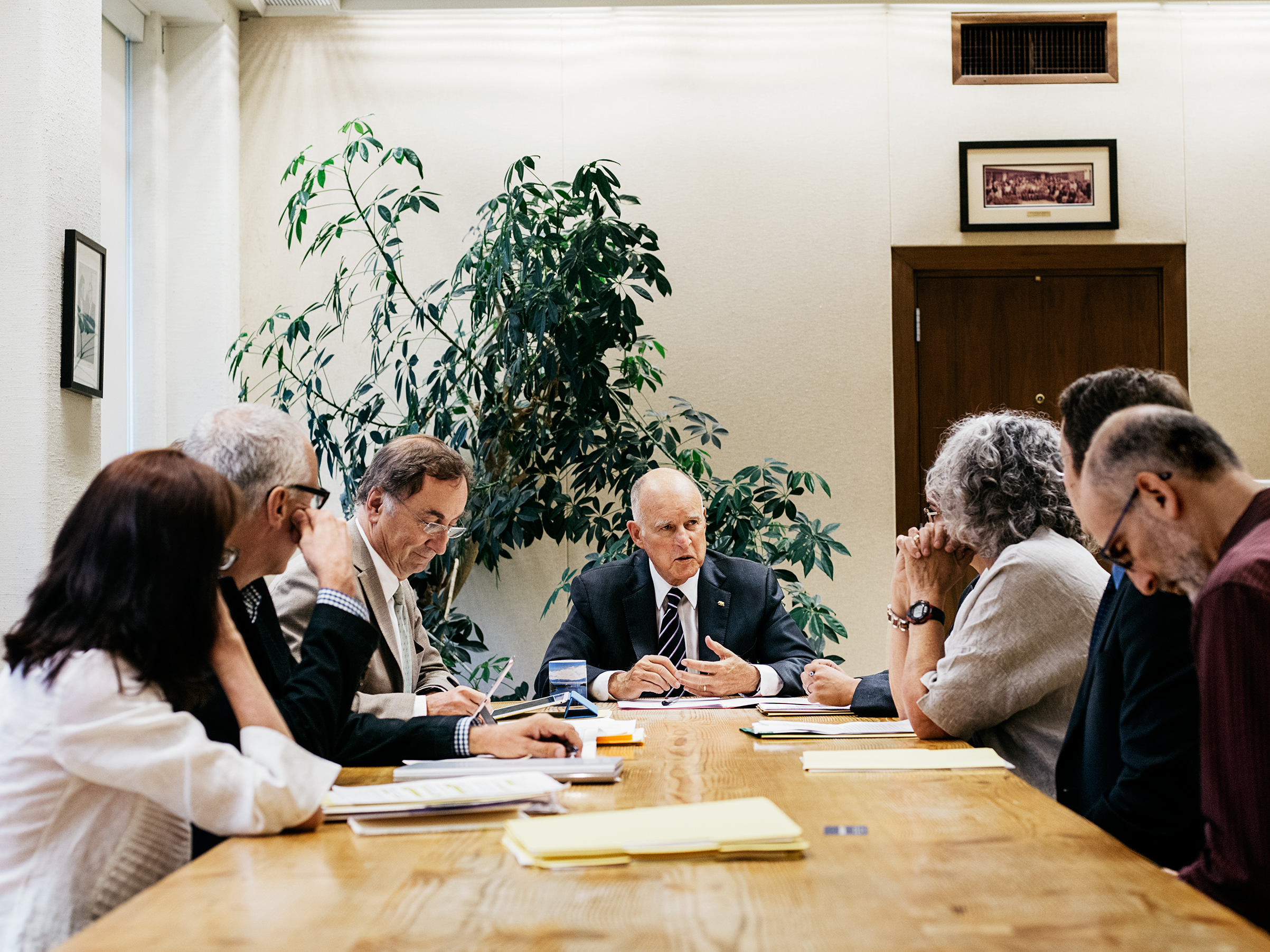 Brown hosts a meeting with environmental experts at his office in Sacramento