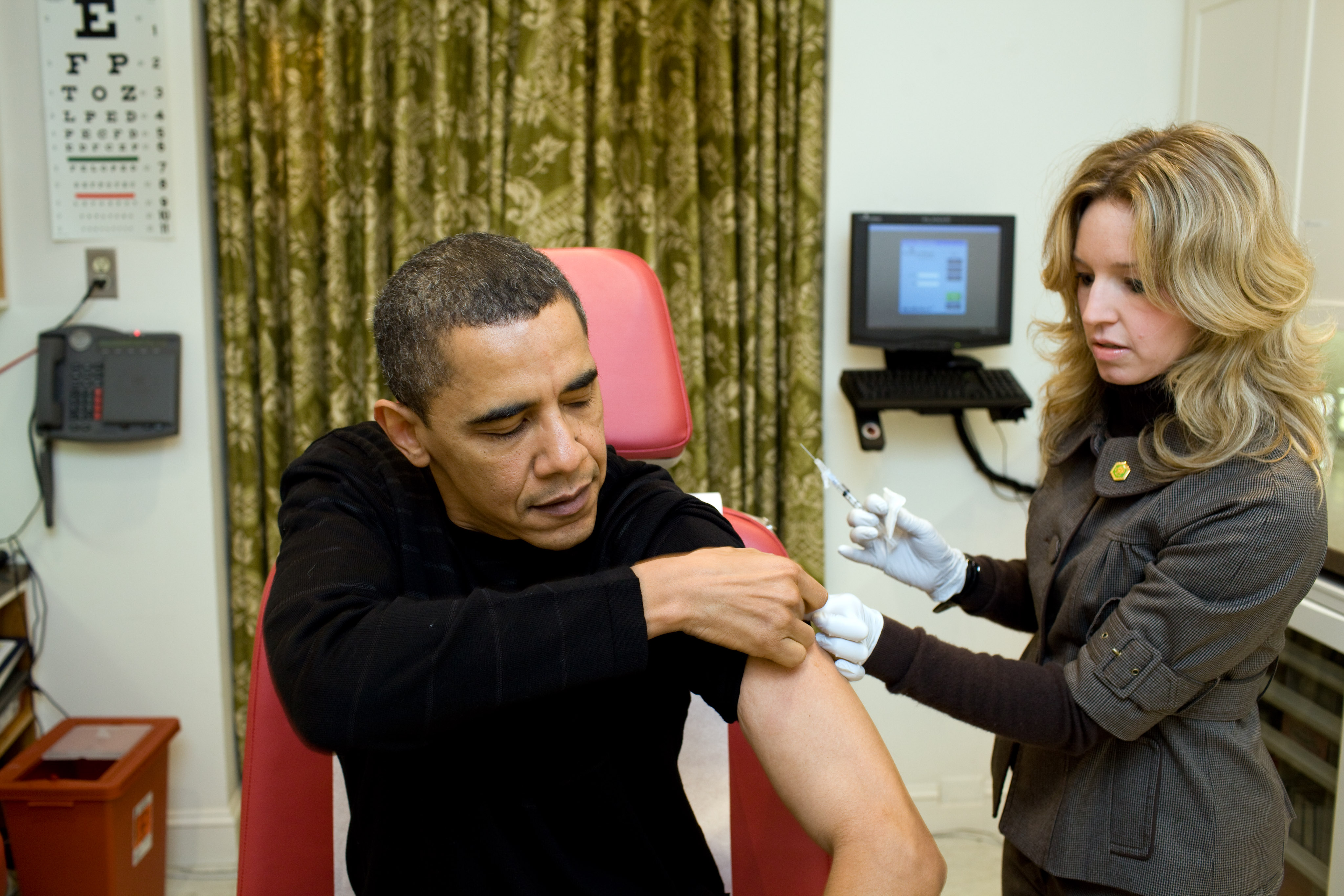 In this handout provided by the White House, A White House nurse prepares to administer the H1N1 vaccine to President Barack Obama at the White House on December 20, 2009 in Washington, DC.