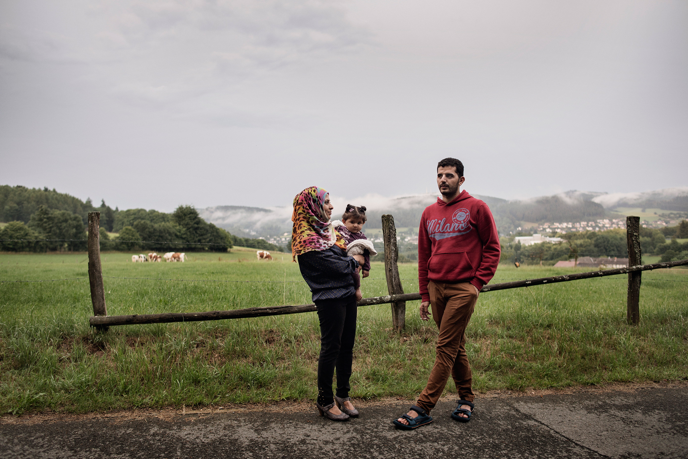 Nour Altallaa, her husband Yousef Alarsan and their daughter Rahaf explore their new home in a camp near Bad Berleburg,                    Germany, on July 19