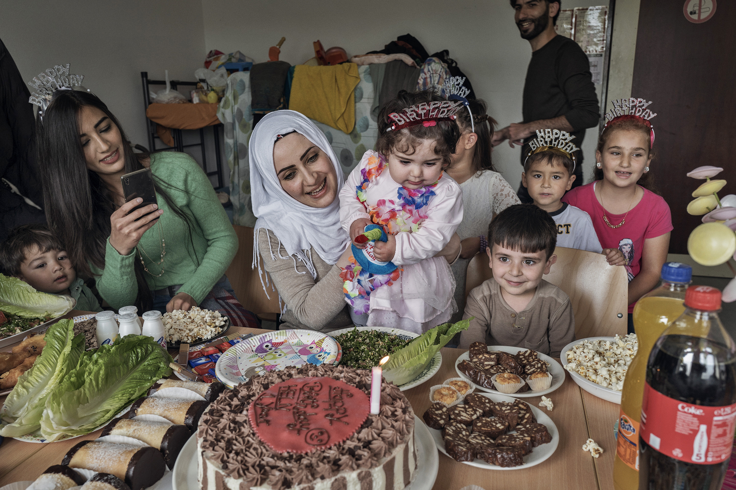 Taimaa Abazli celebrates the first birthday of her daughter Heln in a refugee camp in Kusel, Germany, on Sept. 13; she and her husband Mohannad were denied asylum in Germany but are appealing the ruling