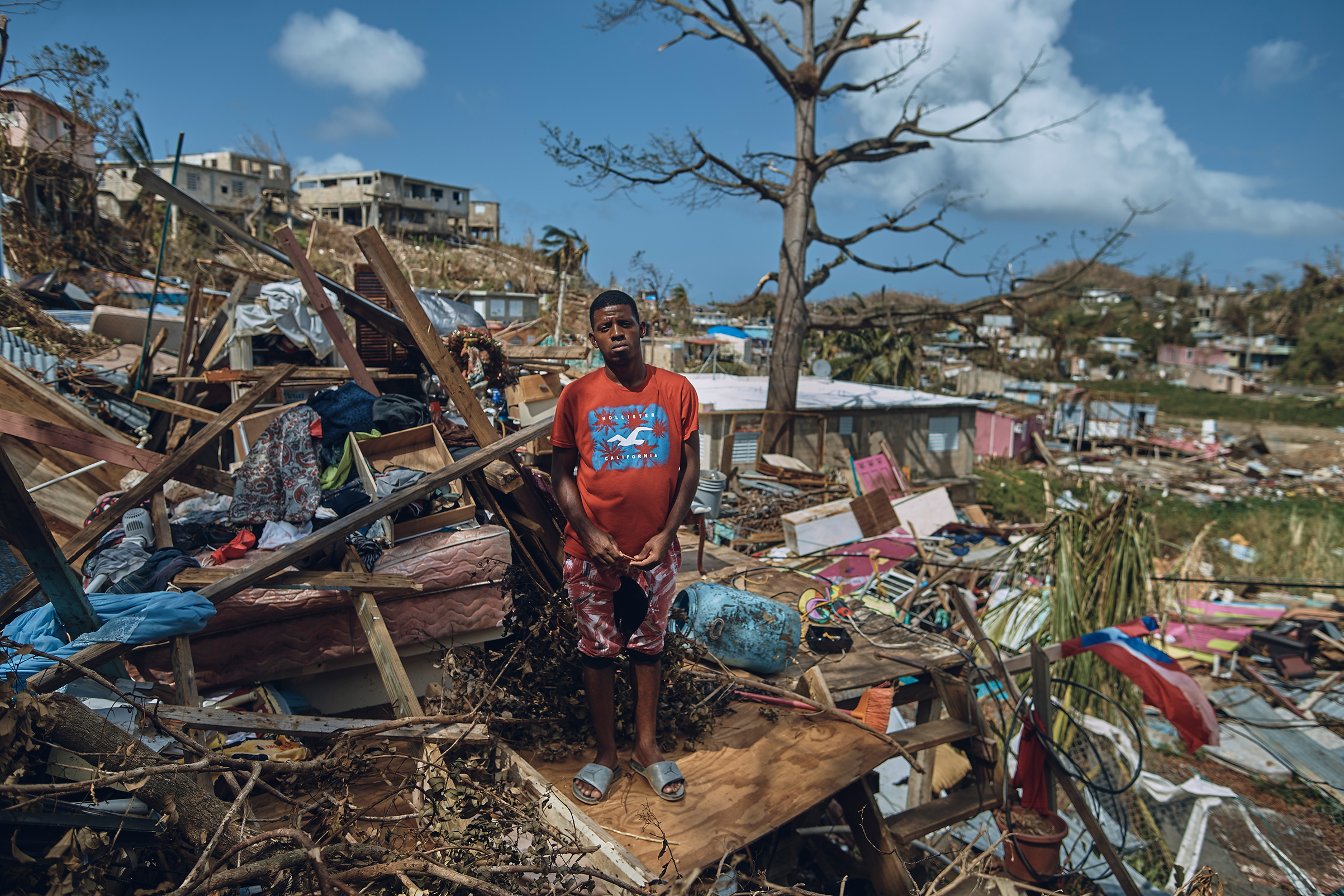 A man who has lived in San Isidro, outside the Puerto Rico capital since he was nine years old, stands for a portrait in his neighborhood, torn apart by Hurricane Maria, on Sept. 28, 2017.
