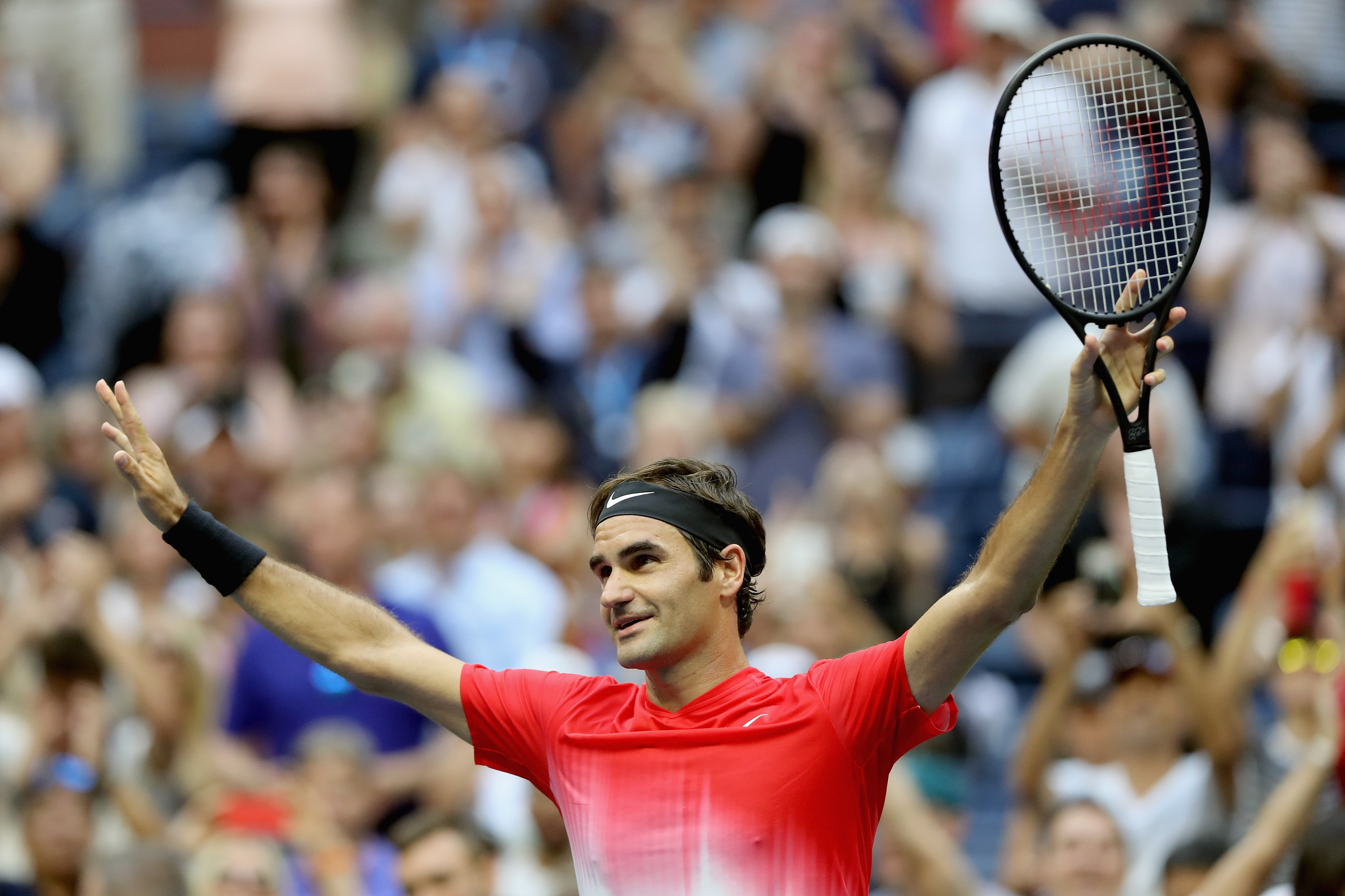 Roger Federer of Switzerland celebrates defeating Mikhail Youzhny of Russia during their second round Men's Singles match on Day Four of the 2017 US Open at the USTA Billie Jean King National Tennis Center.