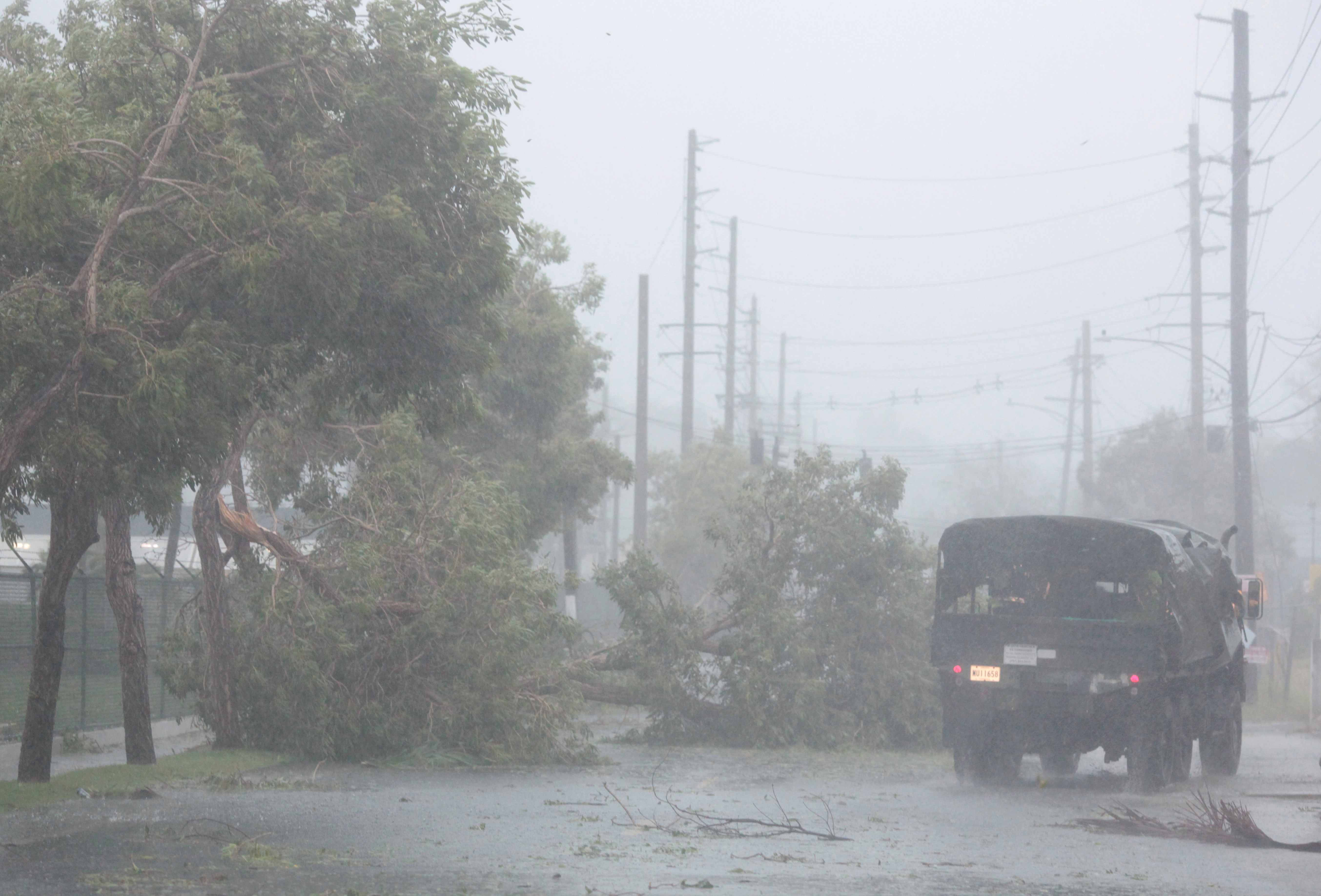 A truck drives past fallen trees as Hurricane Irma howls past Puerto Rico after thrashing several smaller Caribbean islands, in Fajardo, Puerto Rico September 6, 2017.