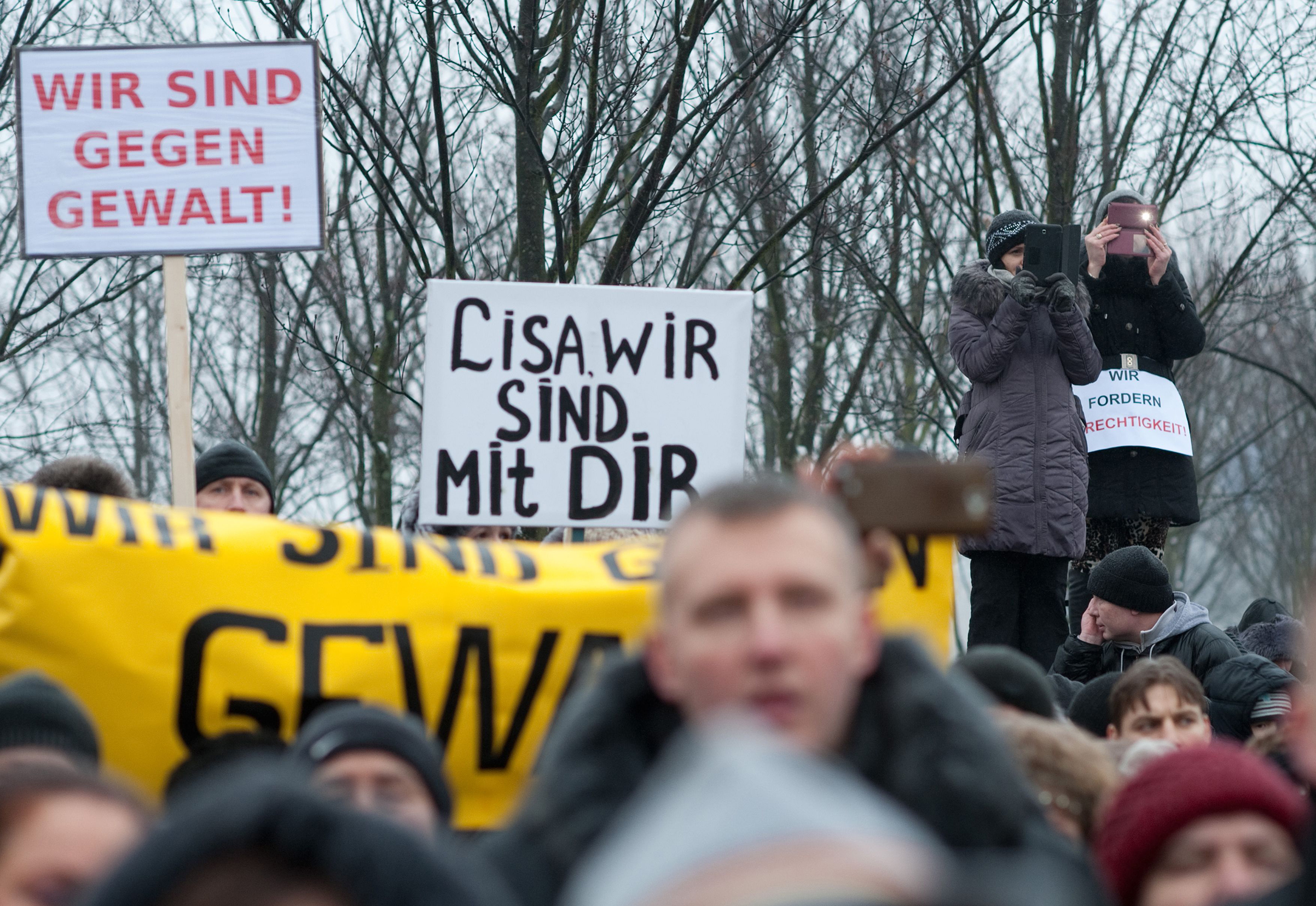 Protesters hold up a sign reading  Lisa, we are with you  as they demonstrate in front of the chancellery after Russian media spread a story -- quickly debunked by German police -- of three Muslim men who raped a 13-year-old Russian-German girl, in Berlin on Jan. 23, 2016.