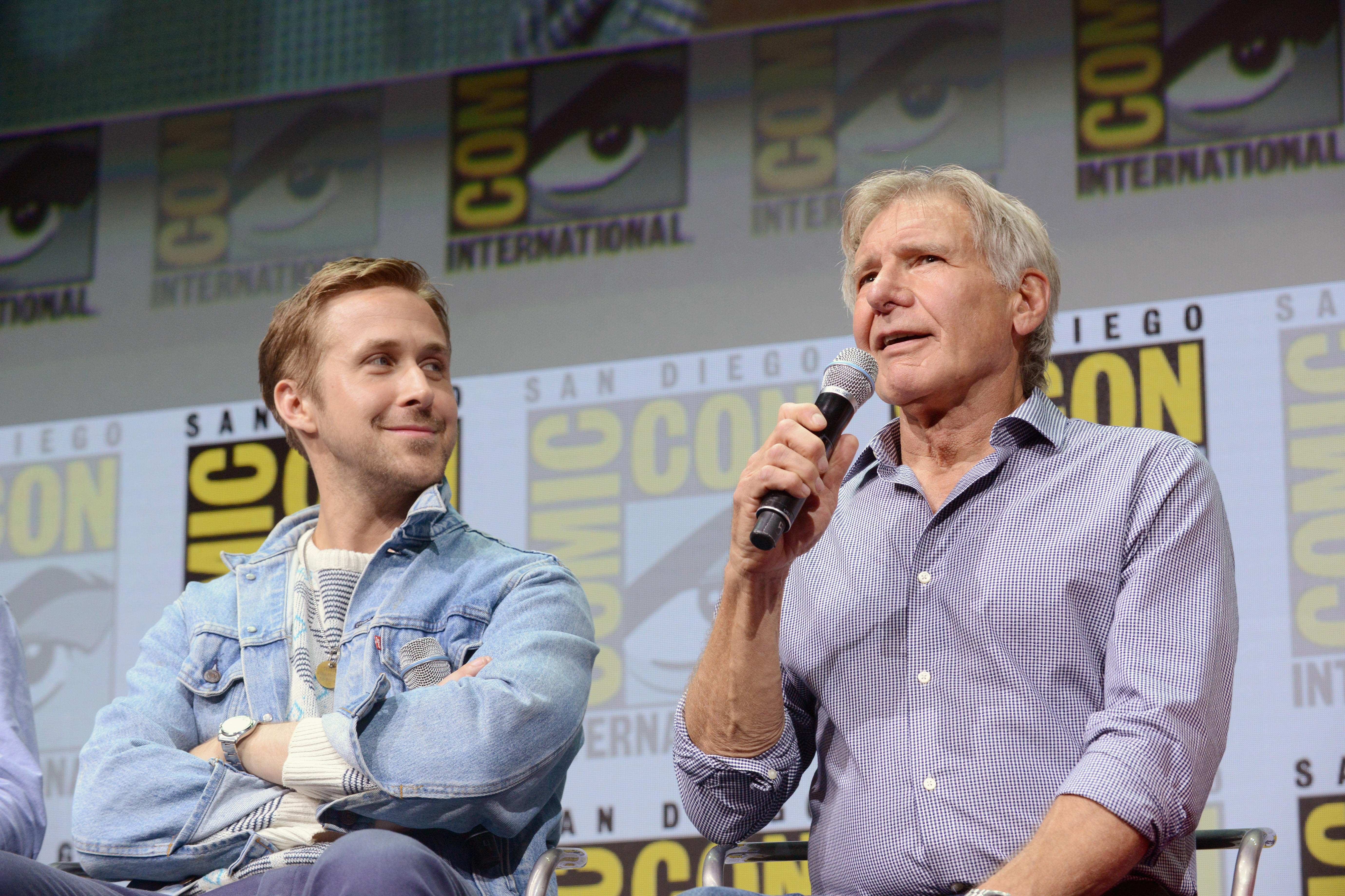 Actors Ryan Gosling (L) and Harrison Ford attend the Warner Bros. Pictures  Blade Runner 2049  Presentation during Comic-Con International 2017 at San Diego Convention Center.