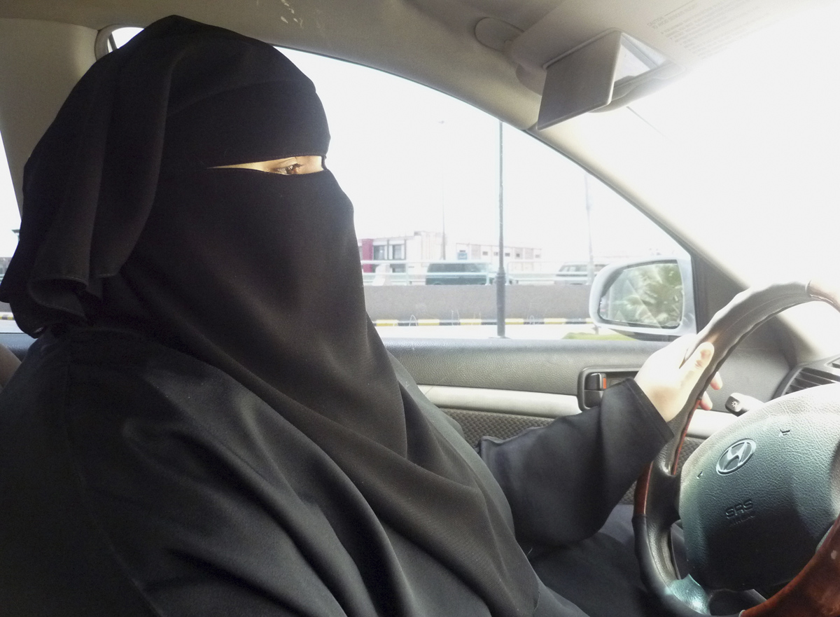 Umm Ibrahim sits behind the wheel of her vehicle as she drives in Riyadh, an act that is banned in Saudi Arabia June 21, 2011.