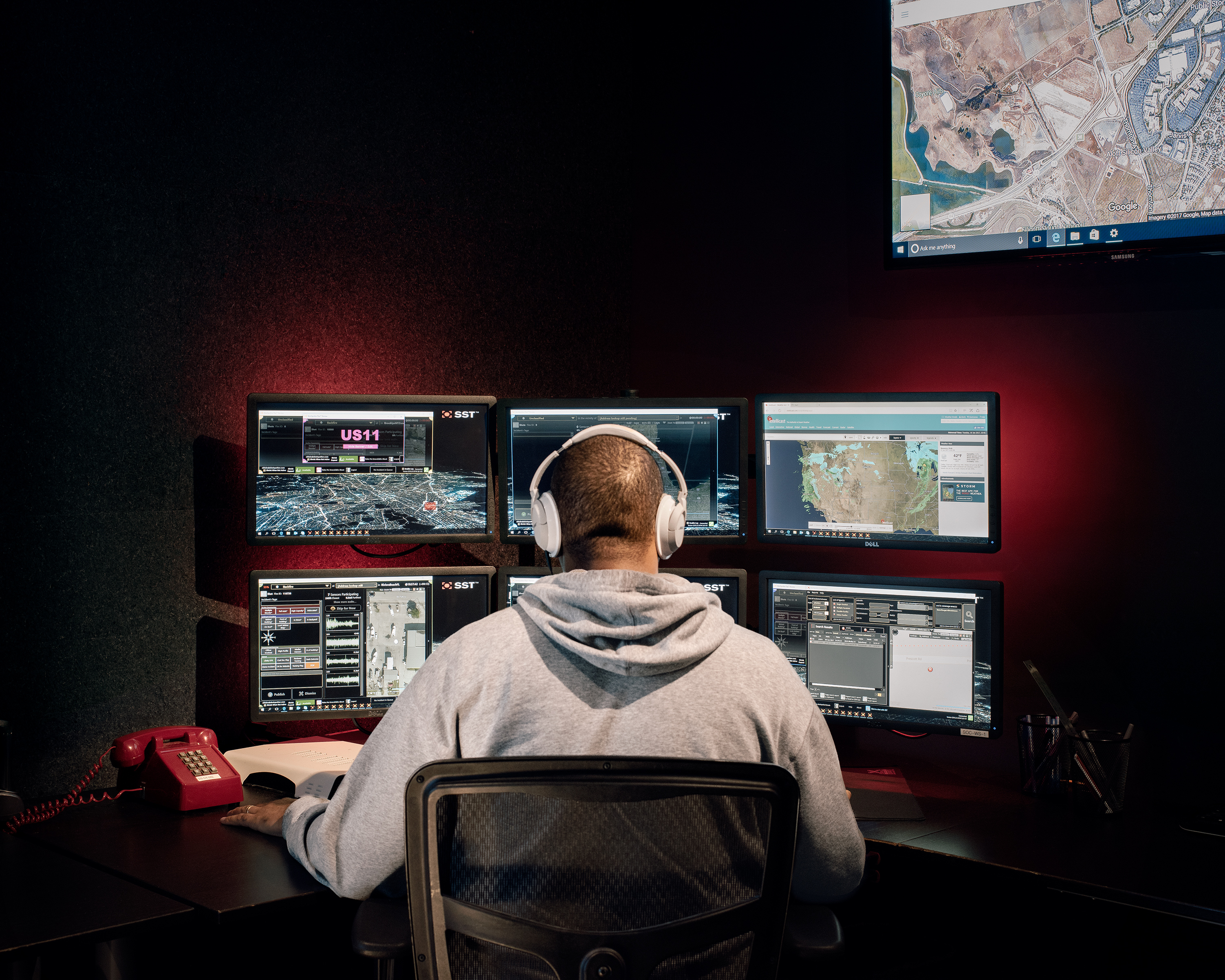 A ShotSpotter analyst reviews possible gun­shots in real time at the company's headquarters