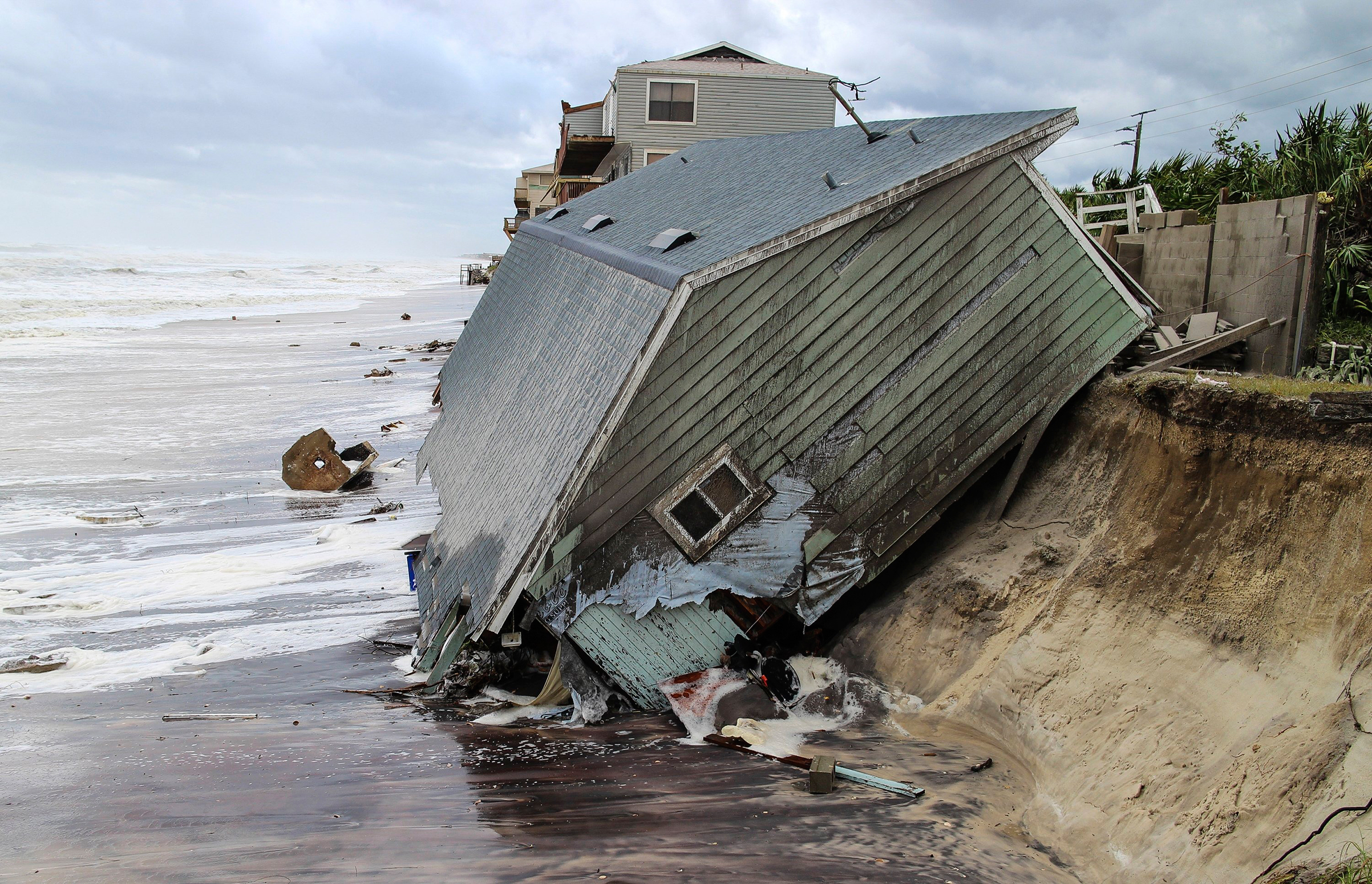 A house slides into the ocean on the Atlantic Coast—one more home built too close to danger