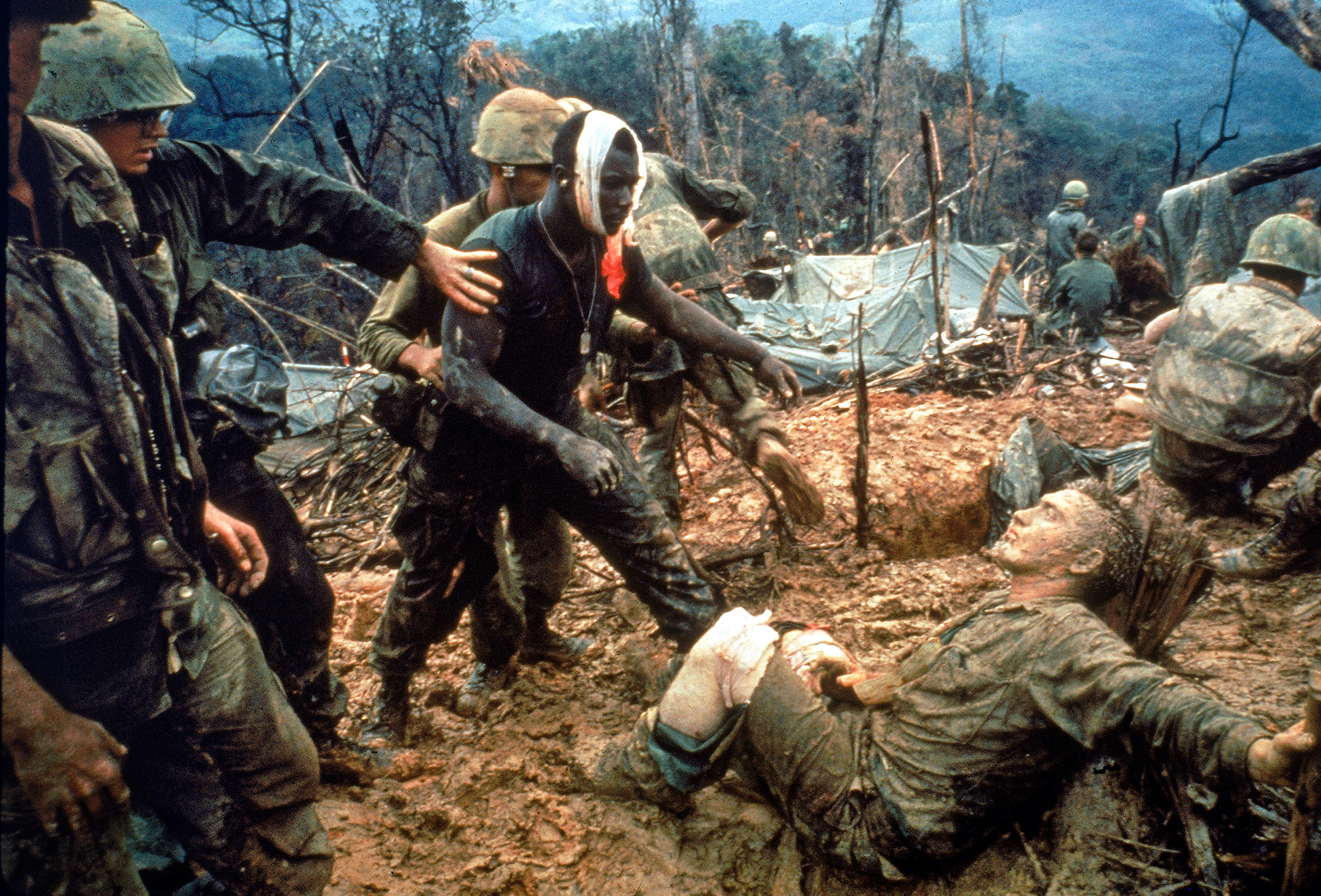 In October 1966, Marine Gunnery Sergeant JeremiahPurdie approached a wounded comradeon Hill484 near the DMZ, in what would become an iconic image of the war. Photographer Larry Burrows was killed in 1971