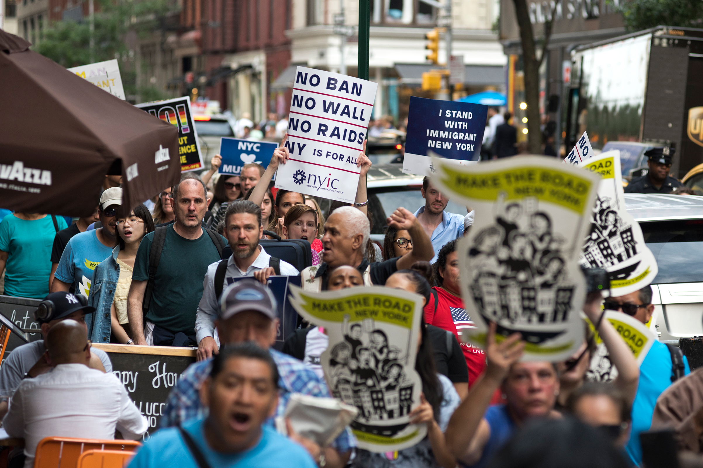 Immigrants join activists for an evening protest in Manhattan hours before a revised version of President Donald Trump's travel ban that was approved by the Supreme Court is to take effect on June 29, 2017 in New York City.