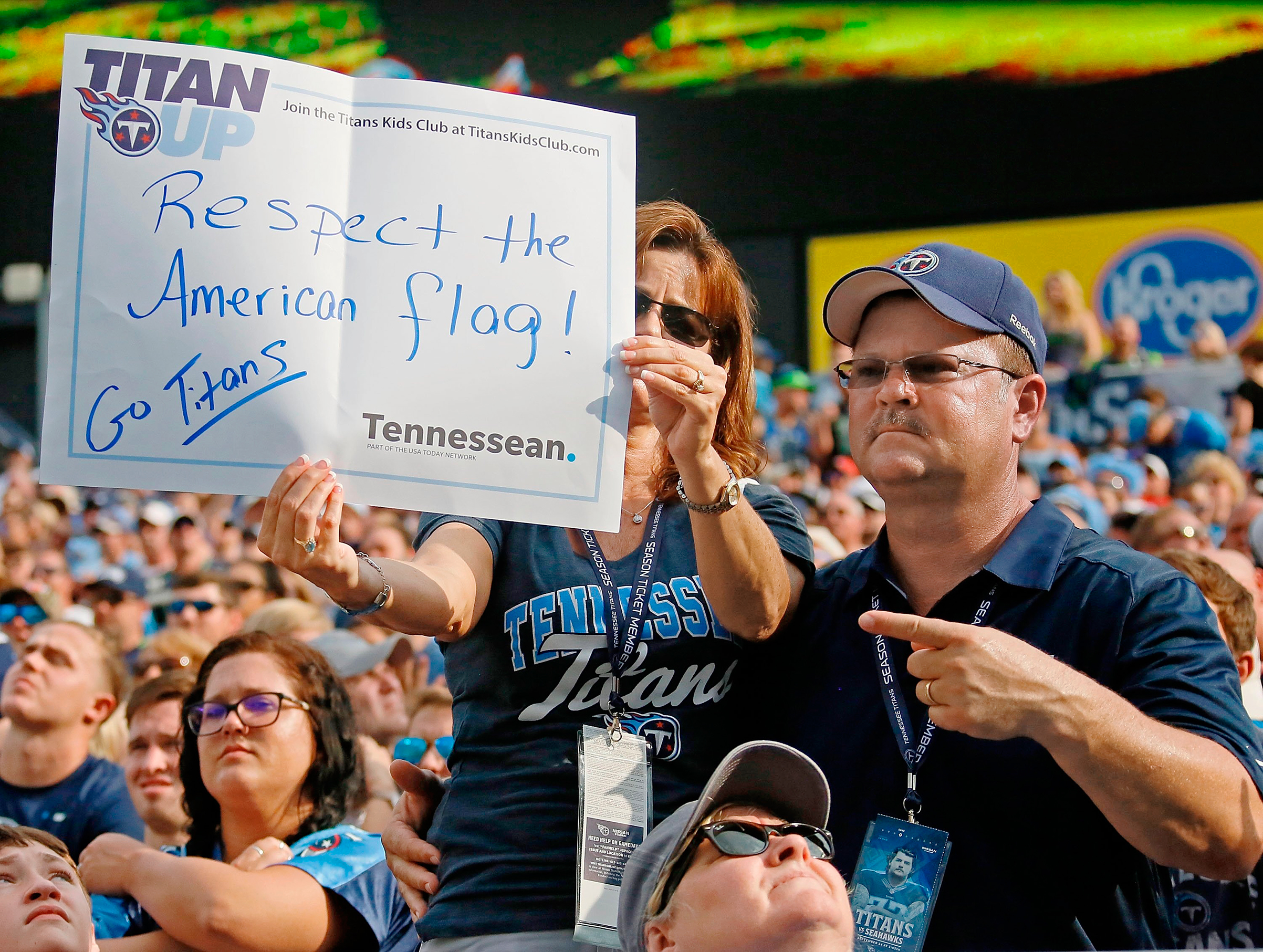 A Tennessee Titans fan hoists a sign during a game against the Seattle Seahawks in Nashville on Sept. 24