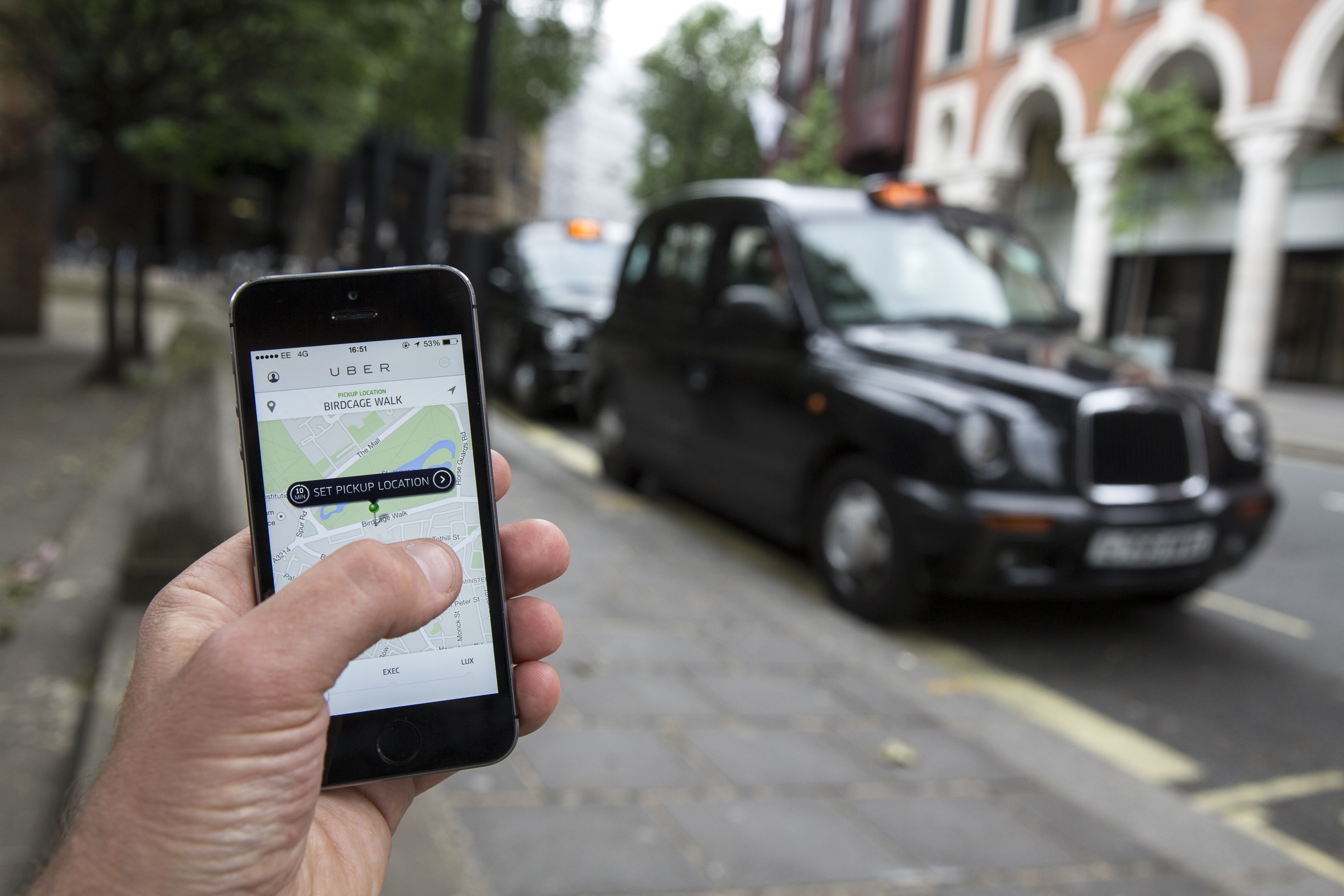 In this photo illustration, a smartphone displays the 'Uber' mobile application which allows users to hail private-hire cars from any location on June 2, 2014 in London, England. (Photo by Oli Scarff/Getty Images)