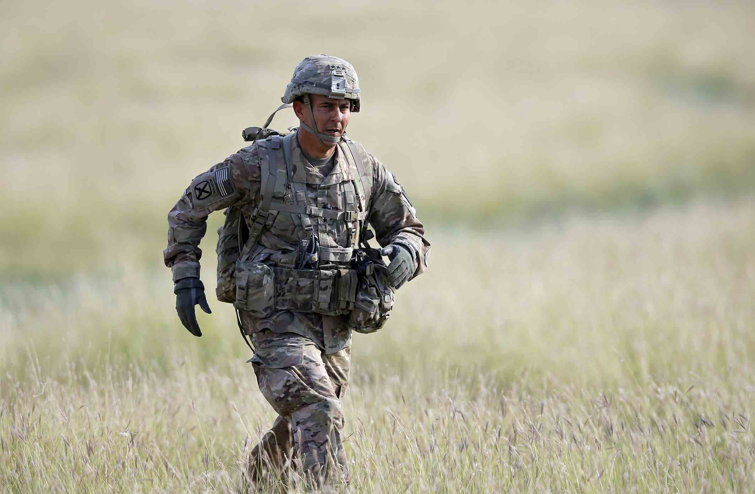 Maj. Gen. Stephen J. Townsend, the commander of the 18th Airborne Corps, runs towards the media working area during an US Army-led airborne assault exercise named 'Swift Response 15', held at Smardan shooting range, 260 kilometers north-east of Bucharest, Romania, Aug. 26 2015.