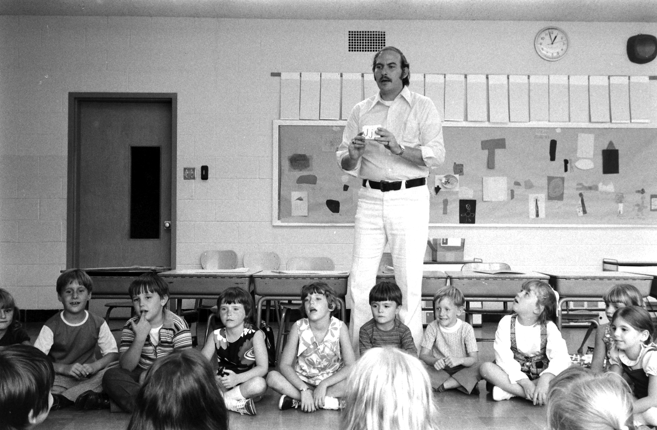 First grade teacher Bill L' Orange with his students at Calumet School in the Chicago suburbs.