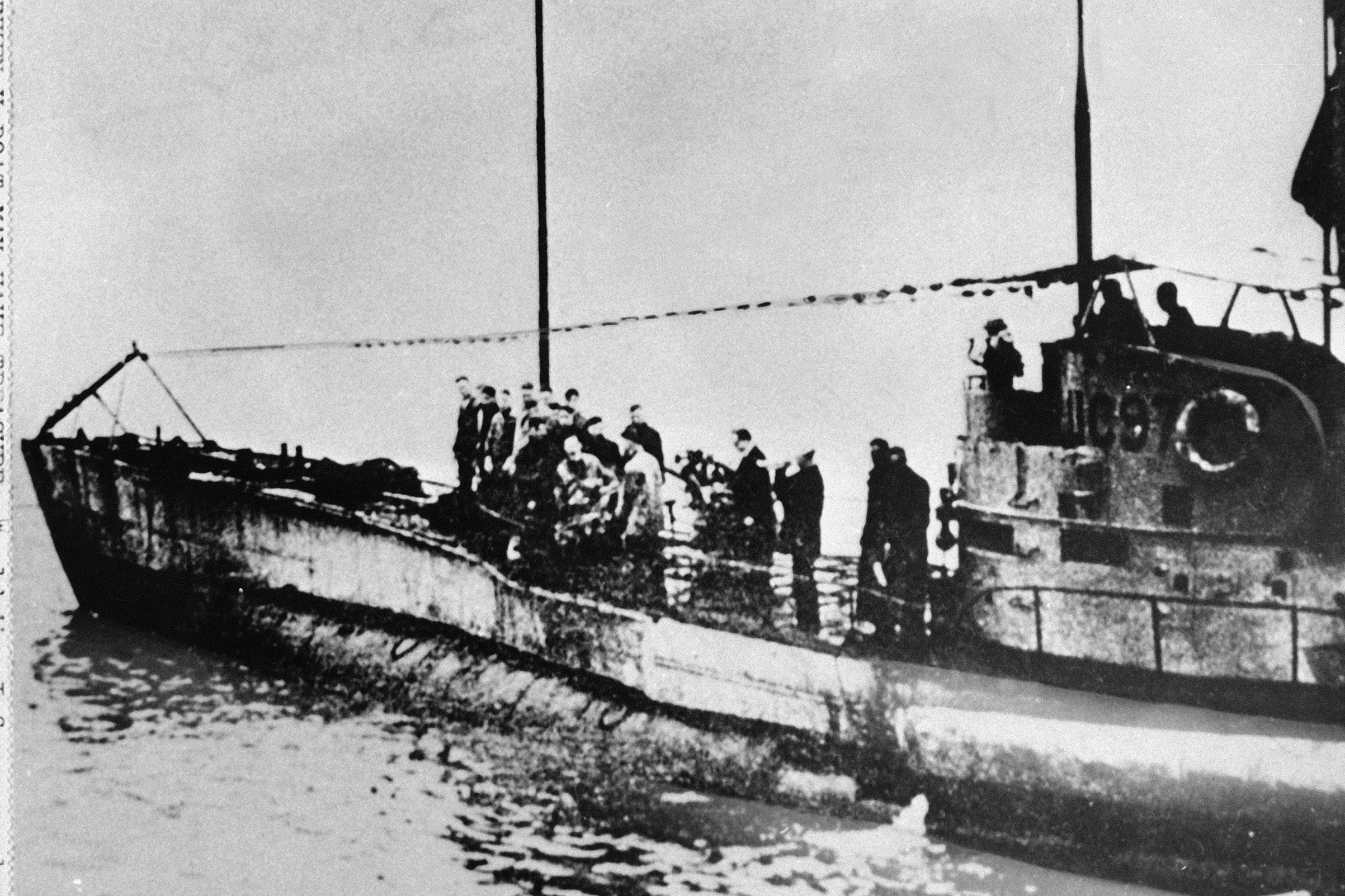 In this undated photo people stand on the deck of a World War I German submarine type UC-97 in an unknown location. Belgian regional authorities on Sept. 19, 2017 say that an intact German World War I submarine has been found off the coast of Belgium.