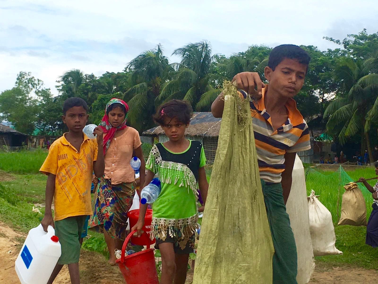 Rohingya refugees walk from the Myanmar border to Kutupalong refugee camp in Bangladesh