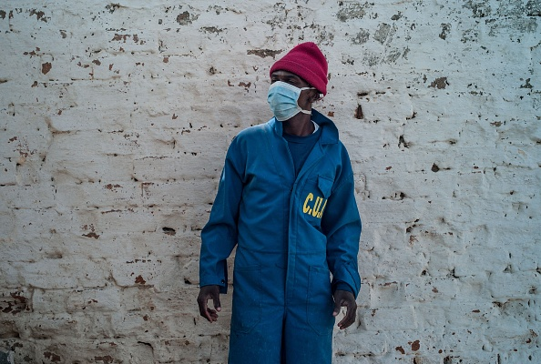 Workers from Department of Emergency and Response to Epidemics and Disasters (SURECA) within the Ministry of Health of Madagascar implement a desinsectisation in a public school in Antananarivo, Madagascar as plague spreads rapidly in cities across the country on October 3, 2017.