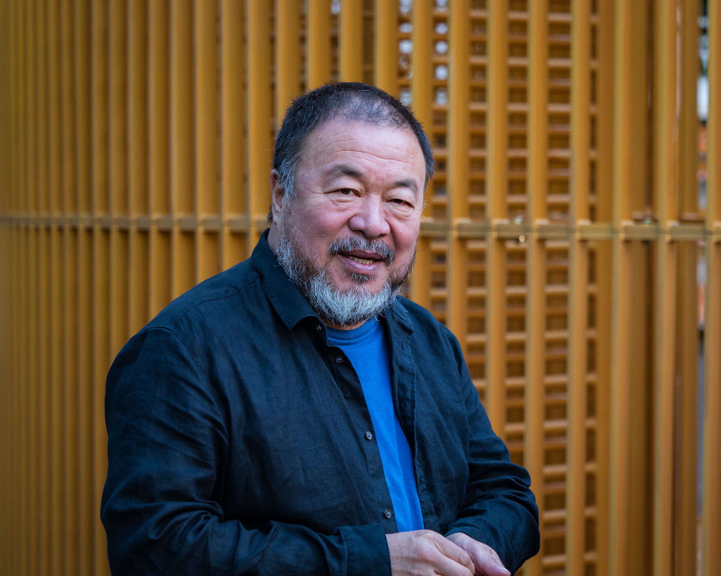 Chinese contemporary artist and activist Ai Weiwei attends the news conference for his instillation 'Good Fences Make Good Neighbors,' in Manhattan on Oct. 10, 2017.