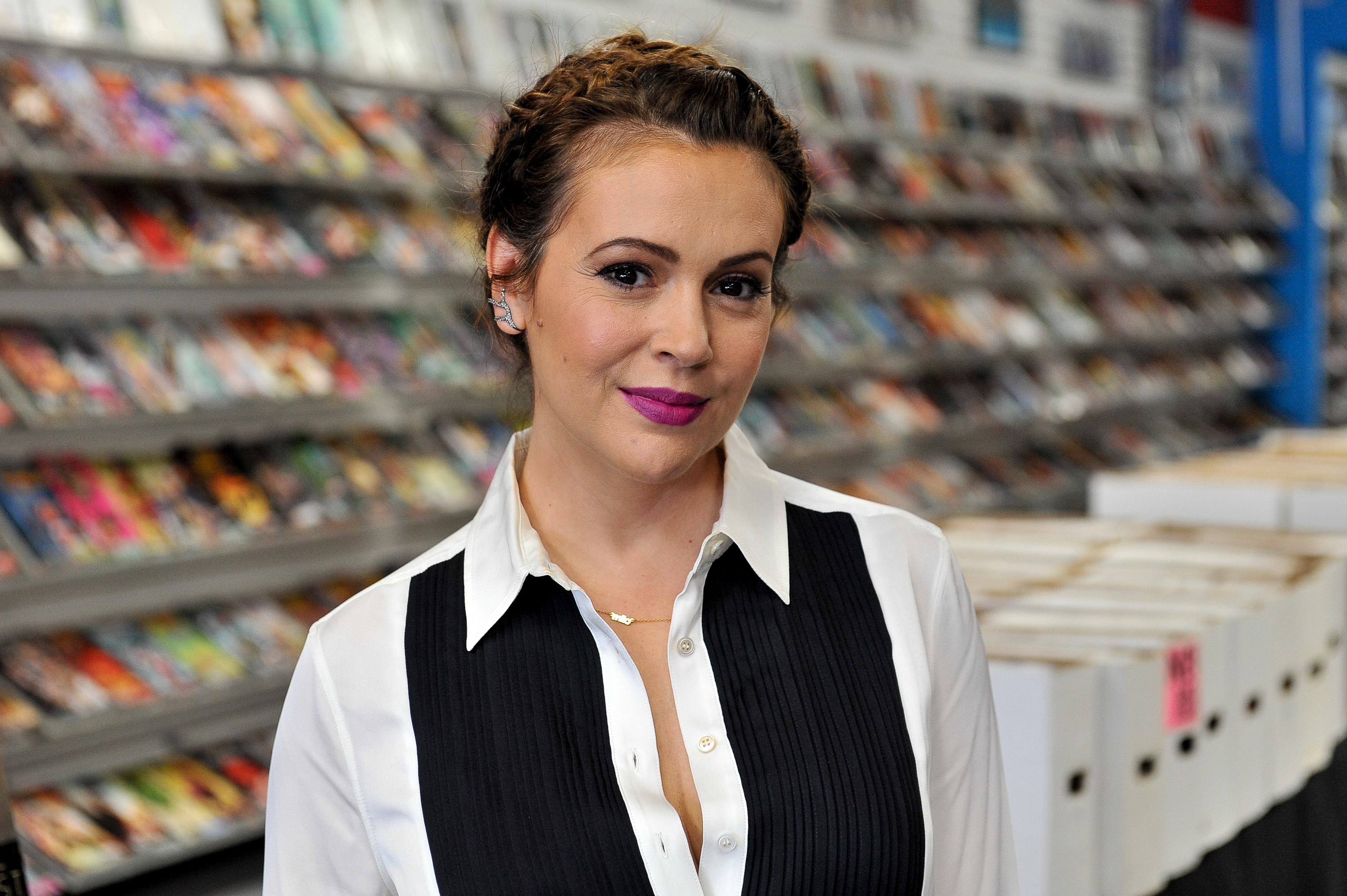 Actress Alyssa Milano attends the signing of  Hacktivist Vol. 2 #1  at The Comic Bug on July 29, 2015 in Manhattan Beach, California.