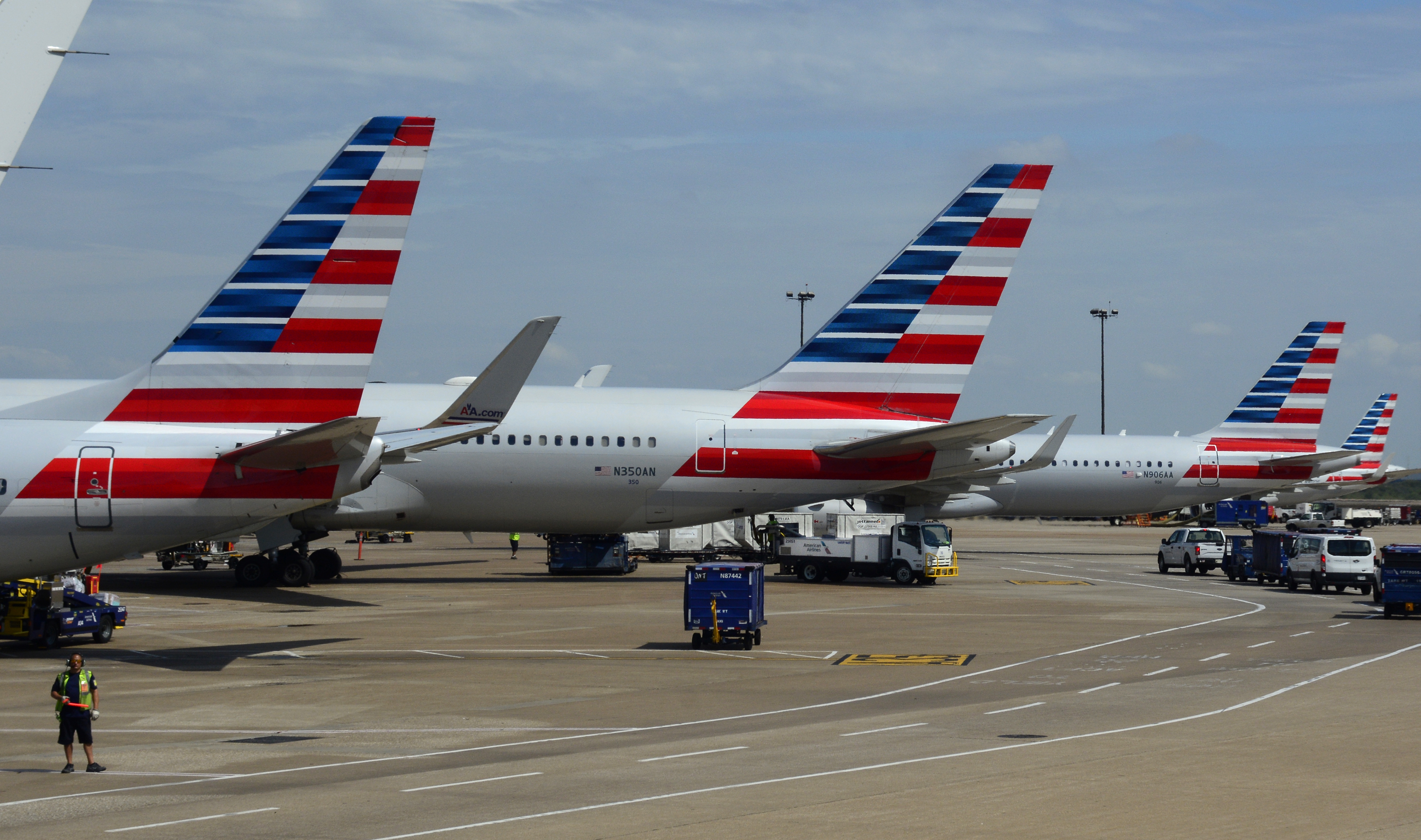 American Airlines passenger jets parked at gates at Dallas/Fort Worth International Airport in Texas.