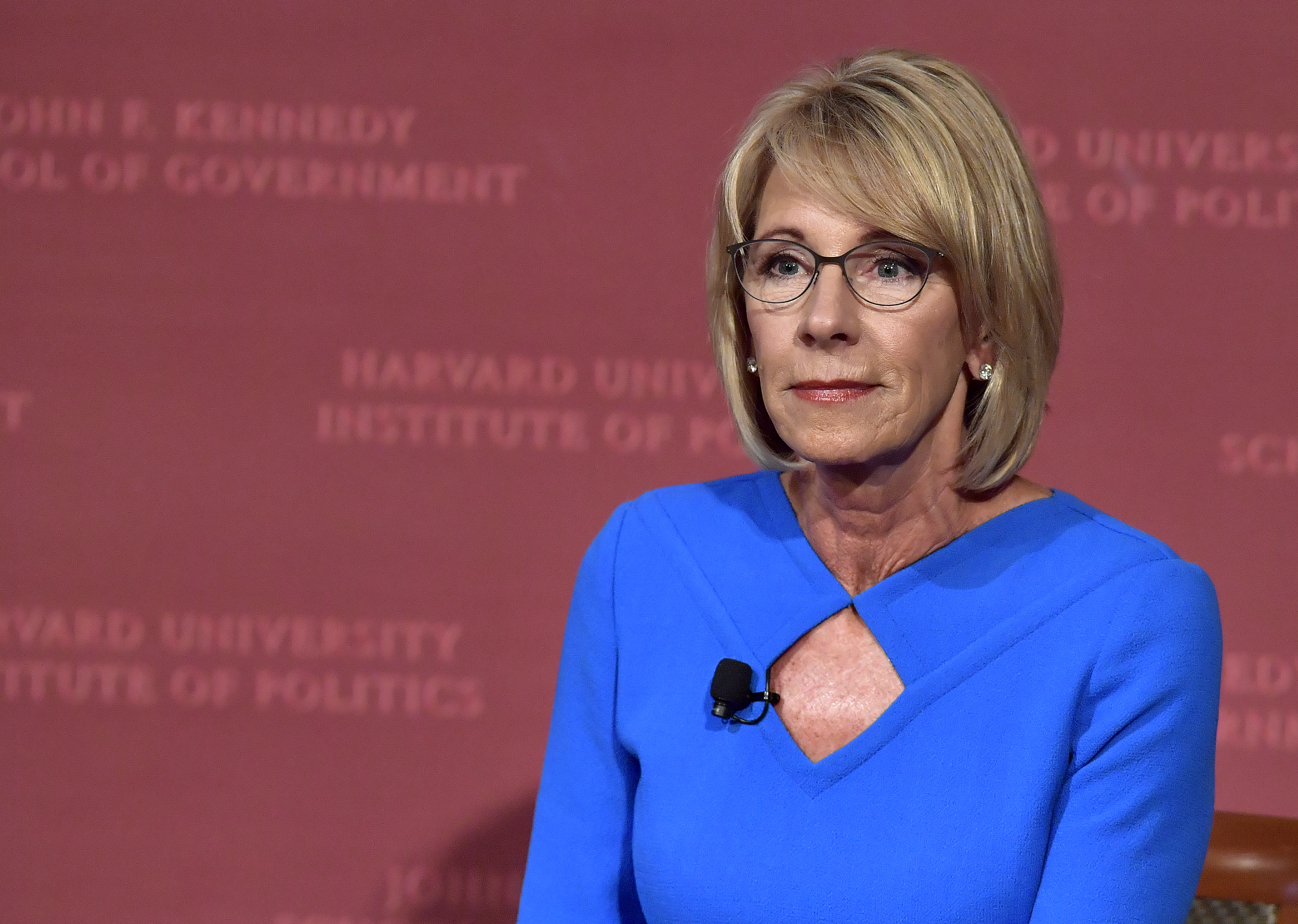 CAMBRIDGE, MA - SEPTEMBER 28:  Education Secretary Betsy DeVos listens during the Harvard University John F. Kennedy Jr. Forum on  A Conversation On Empowering Parents  moderated by Paul Peterson on September 28, 2017 in Cambridge, Massachusetts.  DeVos was met by protestors both outside the venue and inside during her remarks.  (Photo by Paul Marotta/Getty Images)