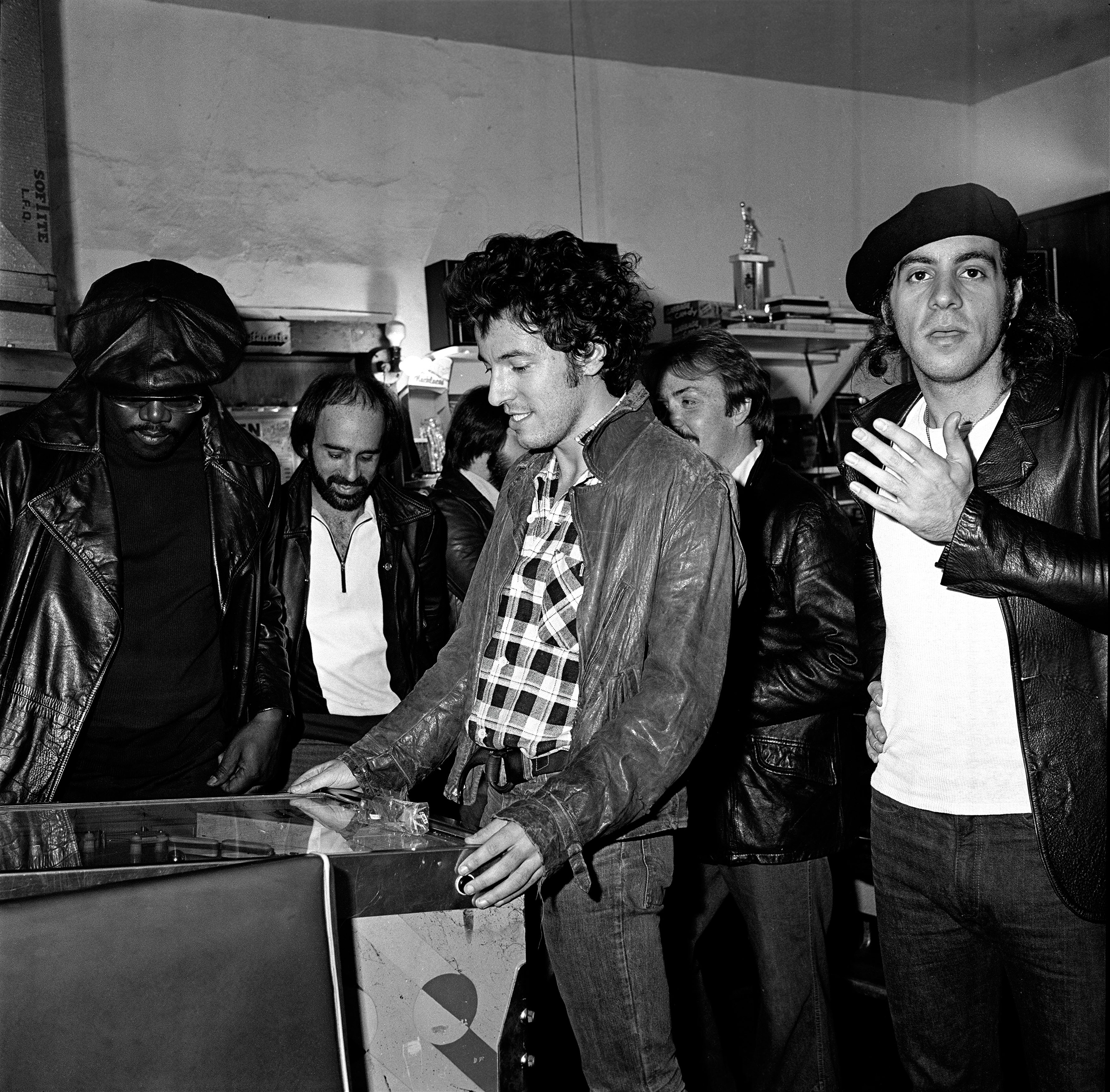 Bruce Springsteen and the E Street band playing pinball at Shellow's Luncheonette, East Camden,                               NJ, 1978.