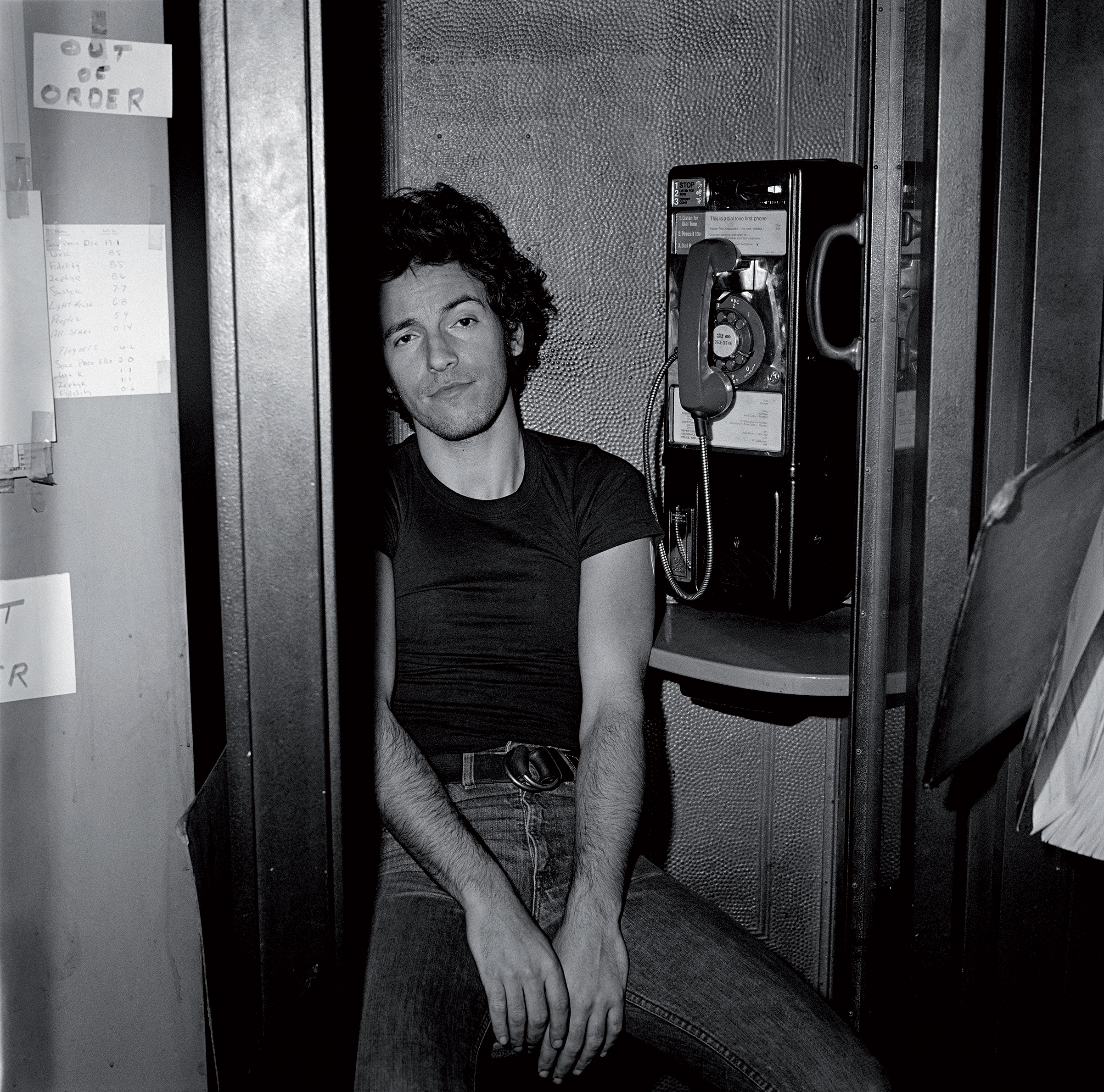 Bruce Springsteen in the phone booth                               at Shellow's Luncheonette, East Camden,                               NJ, 1978.