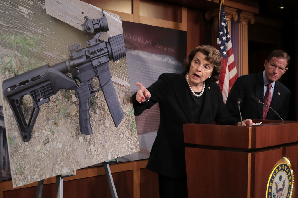 WASHINGTON, DC - OCTOBER 04:  Sen. Dianne Feinstein (D-CA) (C) and Sen. Richard Blumenthal (D-CT) points to a photograph of a rifle with a  bump stock  during a news conference to announce proposed gun control legislation at the U.S. Capitol October 4, 2017 in Washington, DC. In reaction to Sunday's mass shooting in Las Vegas that left 59 people dead and hundreds injured, Feinstein's legislation would ban devices that could make weapons fully automatic.  (Photo by Chip Somodevilla/Getty Images)