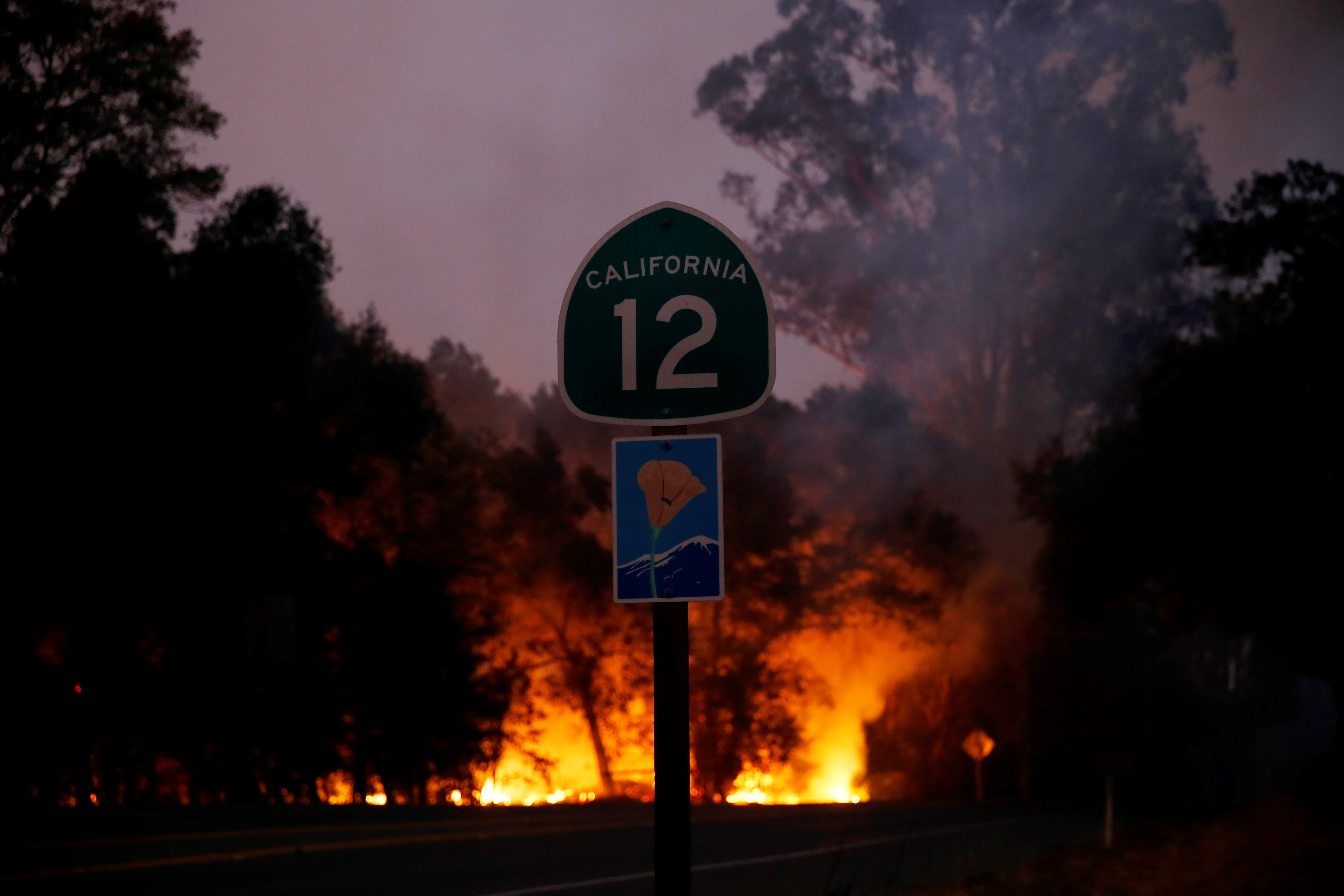 Smoke and flames rise as a wildfire from the Santa Rosa and Napa Valley moves through the area in California, United States on October 10, 2017.